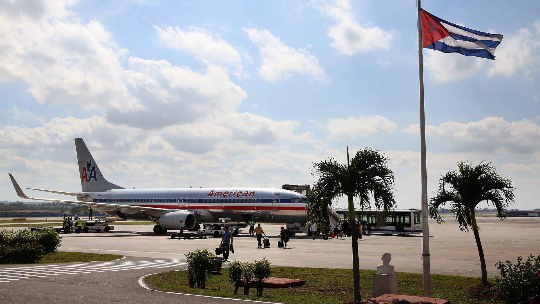 Passengers arrive at Jose Marti International Airport on a charter plane on January 19, 2015 in Havana, Cuba.