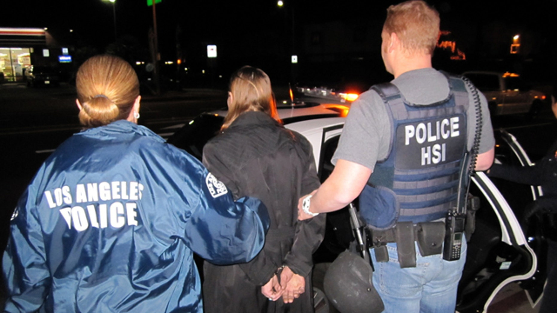 Jan. 4, 2013: In this image provided by U.S. Immigration and Customs Enforcement (ICE), Letha Mae Montemayor, is arrested on suspicion of child pornography charges in Los Angeles.