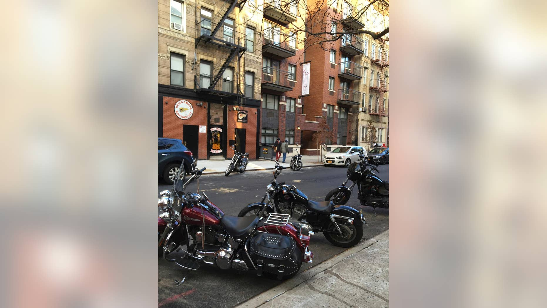 FILE- In this Dec. 16, 2016 file photo, motorcycles are parked on the street outside the Hells Angels motorcycle club headquarters in New York. Authorities said that a man affiliated with the Hells Angels was charged Wednesday, Dec. 21, 2016 in a shooting sparked by a dispute over a parking spot outside the motorcycle club's headquarters on Dec. 11. (AP Photo/Tom Hays, File)