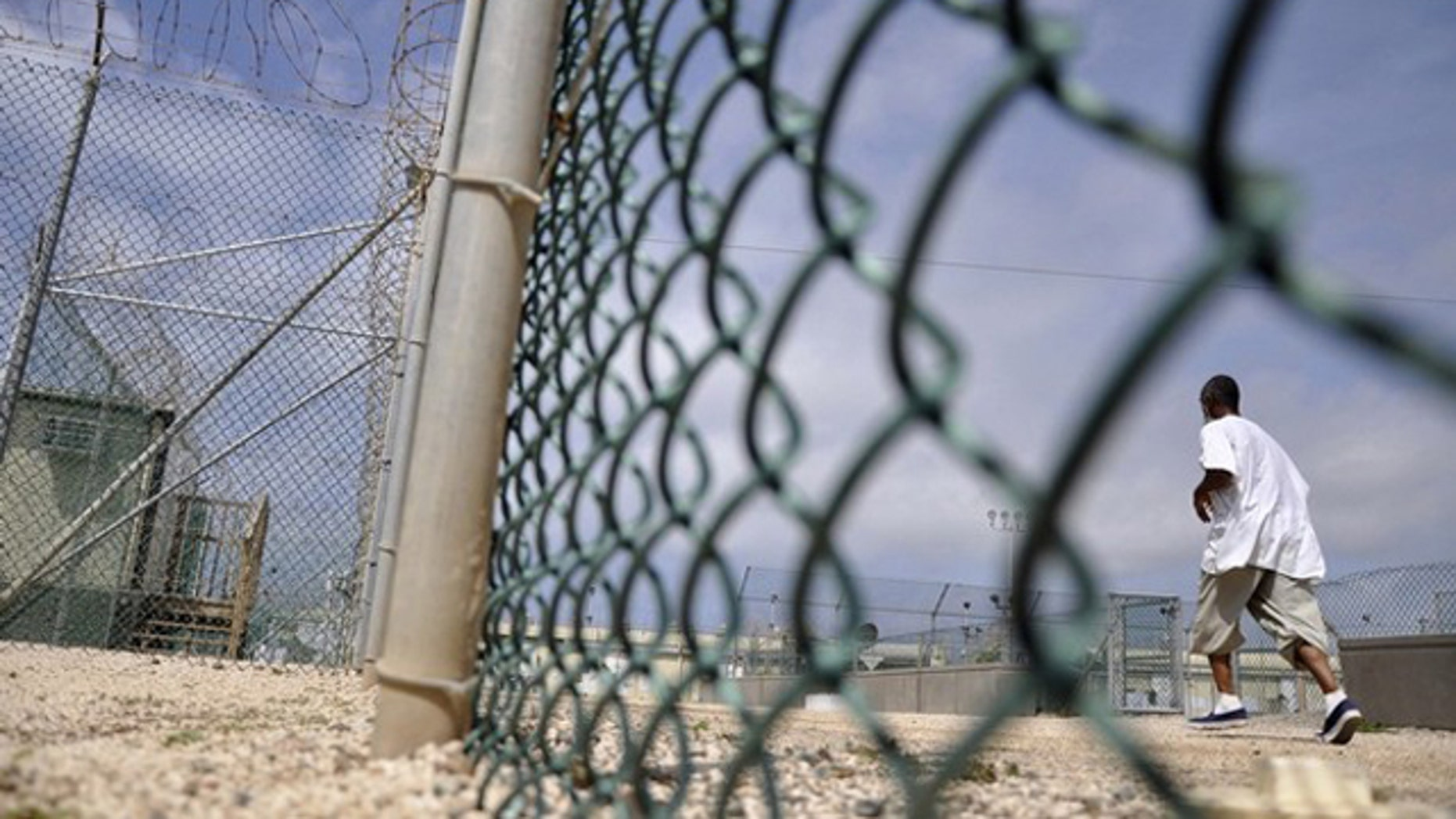 In this April 27, 2010 photo, a detainee runs inside an exercise area at the detention facility at Guantanamo Bay.