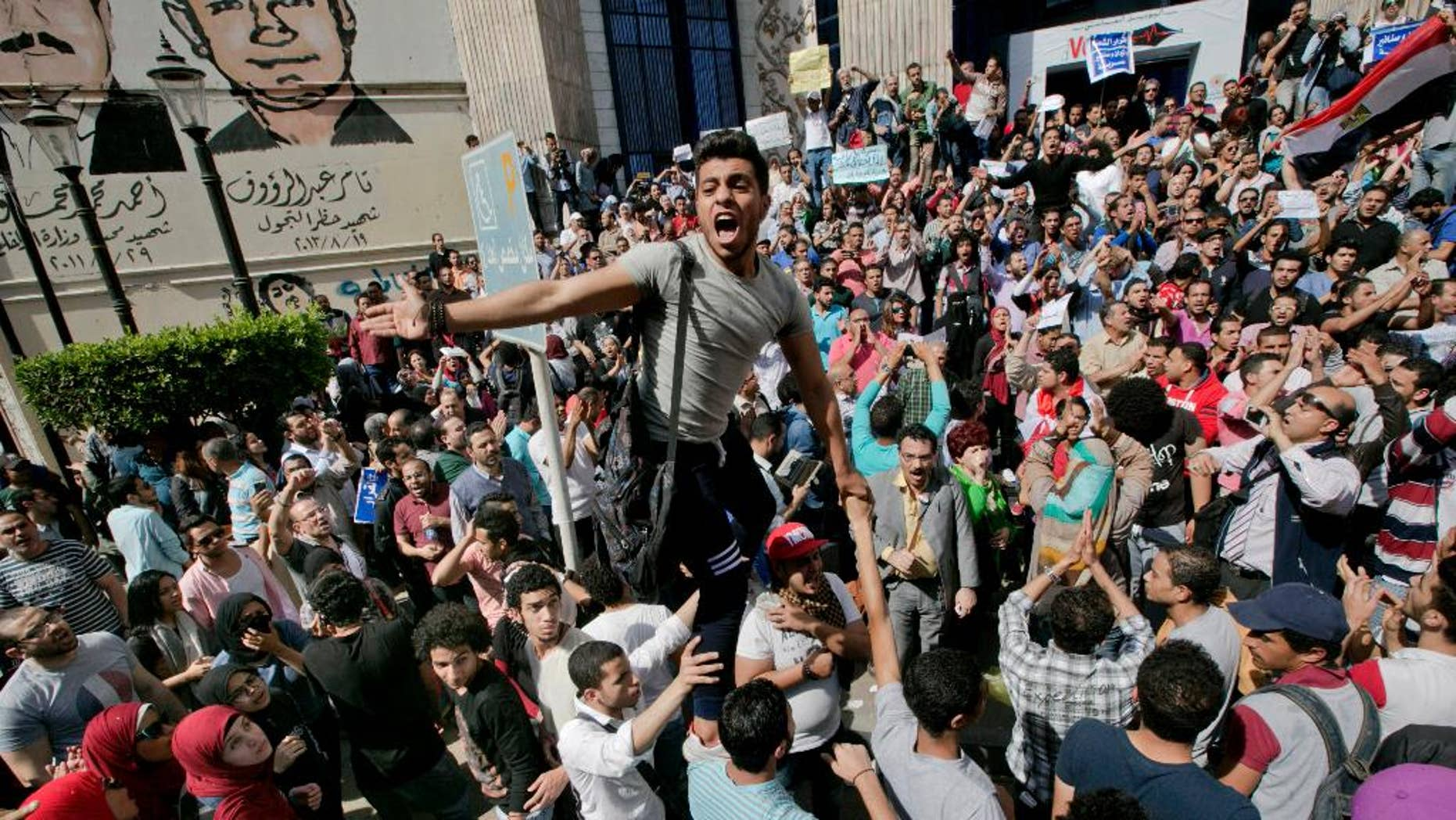 FILE - In this Friday, April 15, 2016 file photo, Egyptians shout slogans against Egyptian President Abdel-Fattah el-Sissi during a protest against the decision to hand over control of two strategic Red Sea islands to Saudi Arabia in front of the Press Syndicate, in Cairo, Egypt. Egyptian security forces have rounded up dozens of activists, journalists, and lawyers ahead of demonstrations called for April 25 against President Abdel-Fattah el-Sissi's policies, including the transfer of two Red Sea islands to Saudi Arabia, lawyers and witnesses said Friday, April 22. 2016. (AP Photo/Amr Nabil, File)