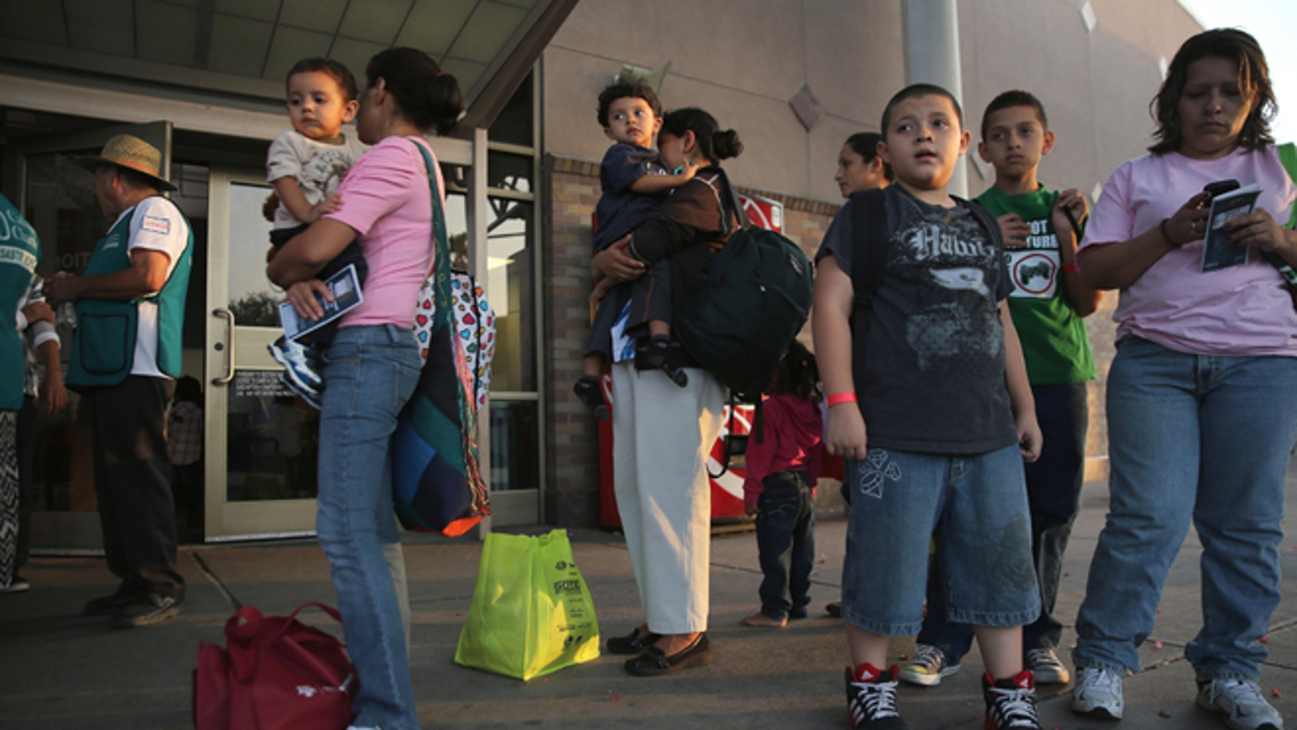 MCALLEN, TX - JULY 25:  Central American immigrants just released from U.S. Border Patrol detention wait at the Greyhound bus station for their continued journey to various U.S. destinations on July 25, 2014 in McAllen, Texas. (Photo by John Moore/Getty Images)