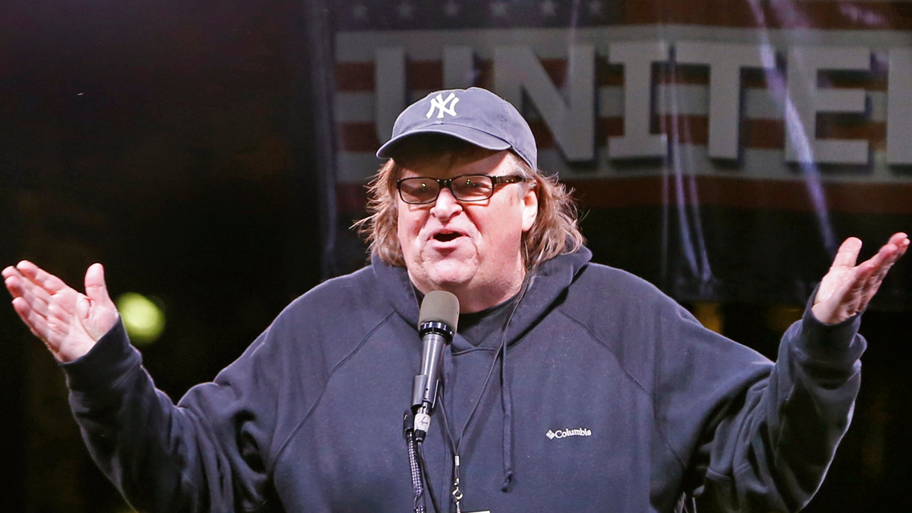 In this Thursday, Jan. 19, 2017, filmmaker Michael Moore speaks to thousands of people at an anti-Trump rally and protest in front of the Trump International Hotel in New York.