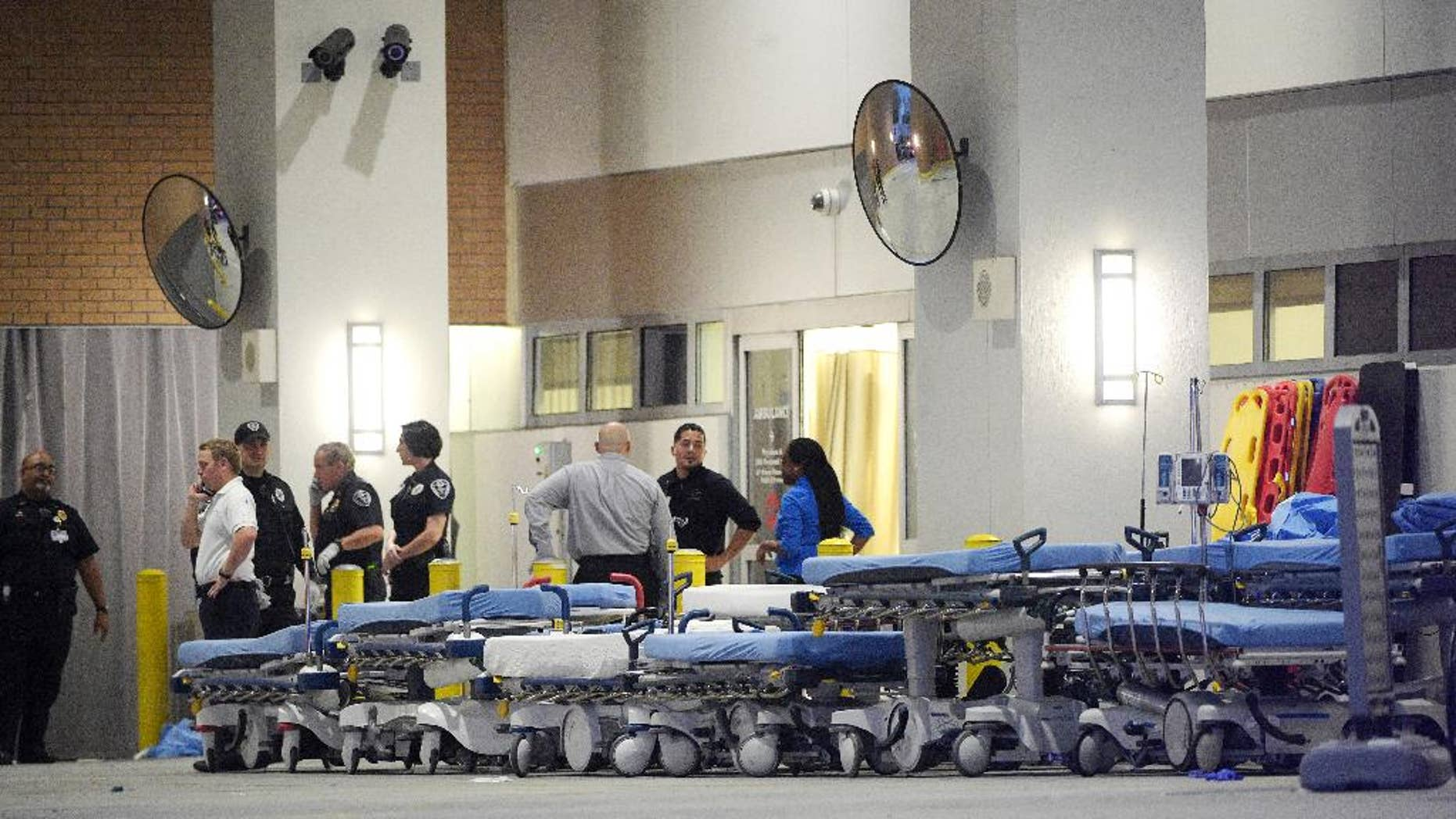 FILE - In this June 12, 2016, file photo,emergency personnel wait with stretchers at the emergency entrance to Orlando Regional Medical Center hospital for the arrival of patients from the scene of a fatal shooting at Pulse Orlando nightclub in Orlando, Fla. Radical Islamic militancy that has sustained itself for decades overseas has inspired a series of attacks on U.S. soil in the last year and a half. The culprits typically have no ties to foreign terrorist organizations, no explicit directions from overseas and no formal training, unlike the operatives of 9/11. Instead, they've blended into American society and skated beneath the radar of federal investigators grappling with a frenetic threat landscape and hundreds of investigations across the country. (AP Photo/Phelan M. Ebenhack, file)