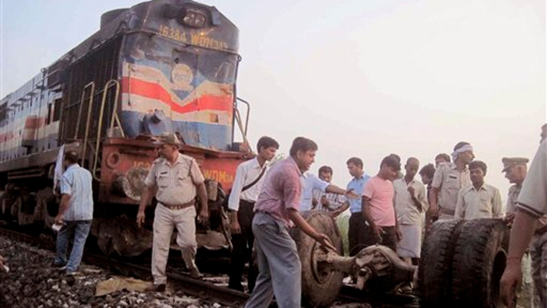 July 07: Volunteers help look for survivors and clear debris after a deadly collision between a train and a bus left 35 dead.