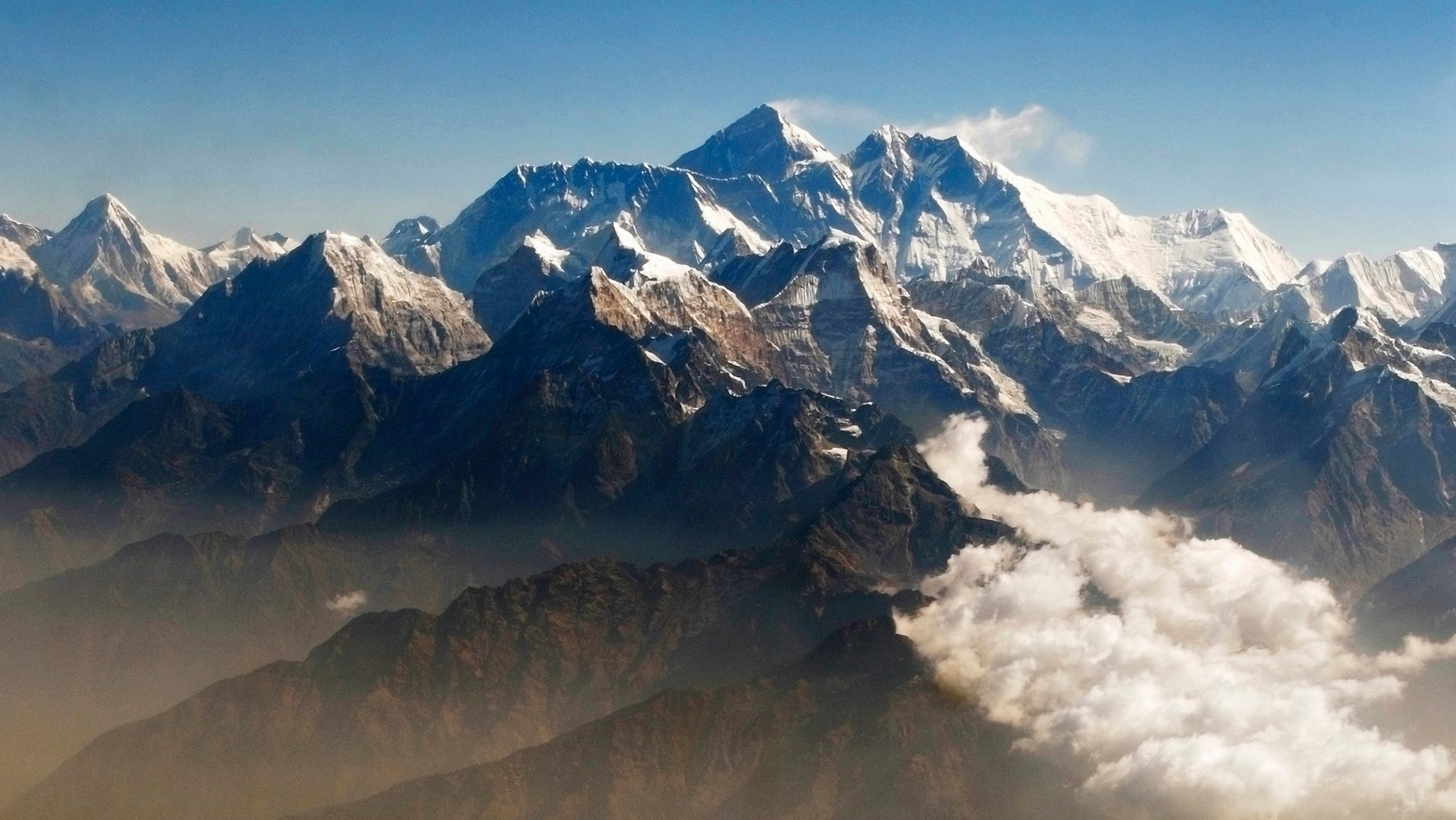 Mount Everest (C), the world highest peak, and other peaks of the Himalayan range are seen from air during a mountain flight from Kathmandu April 24, 2010. (REUTERS/Tim Chong)