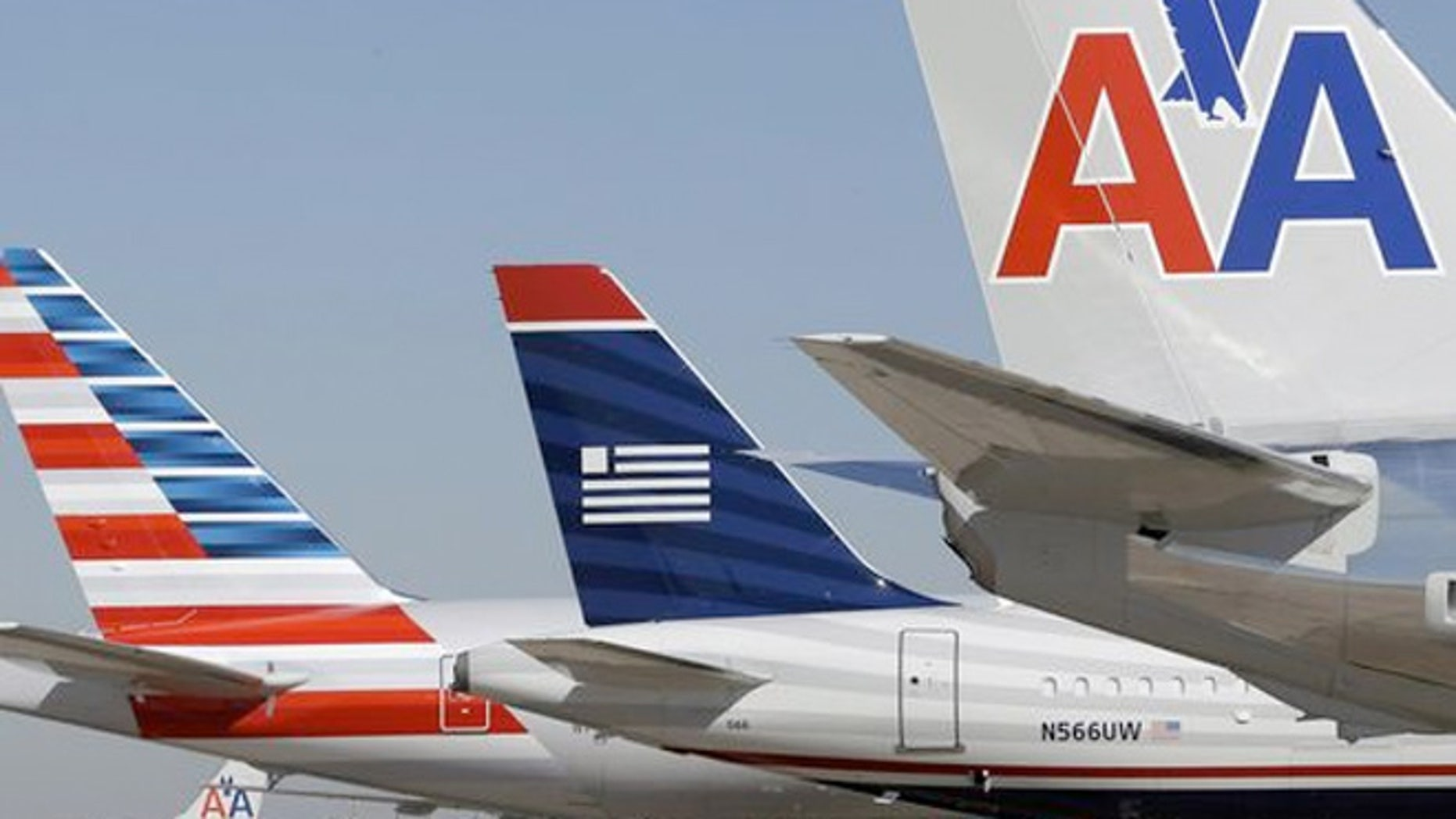 US Airways and American Airlines planes at Dallas/Fort Worth International Airport.