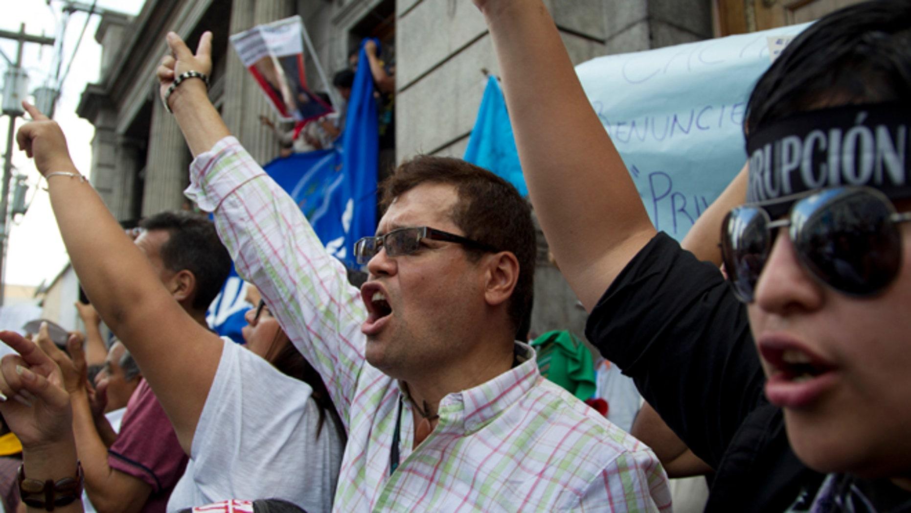 Protesters demand the resignation of Guatemalan President Otto Perez Molina Saturday, May 9, 2015.