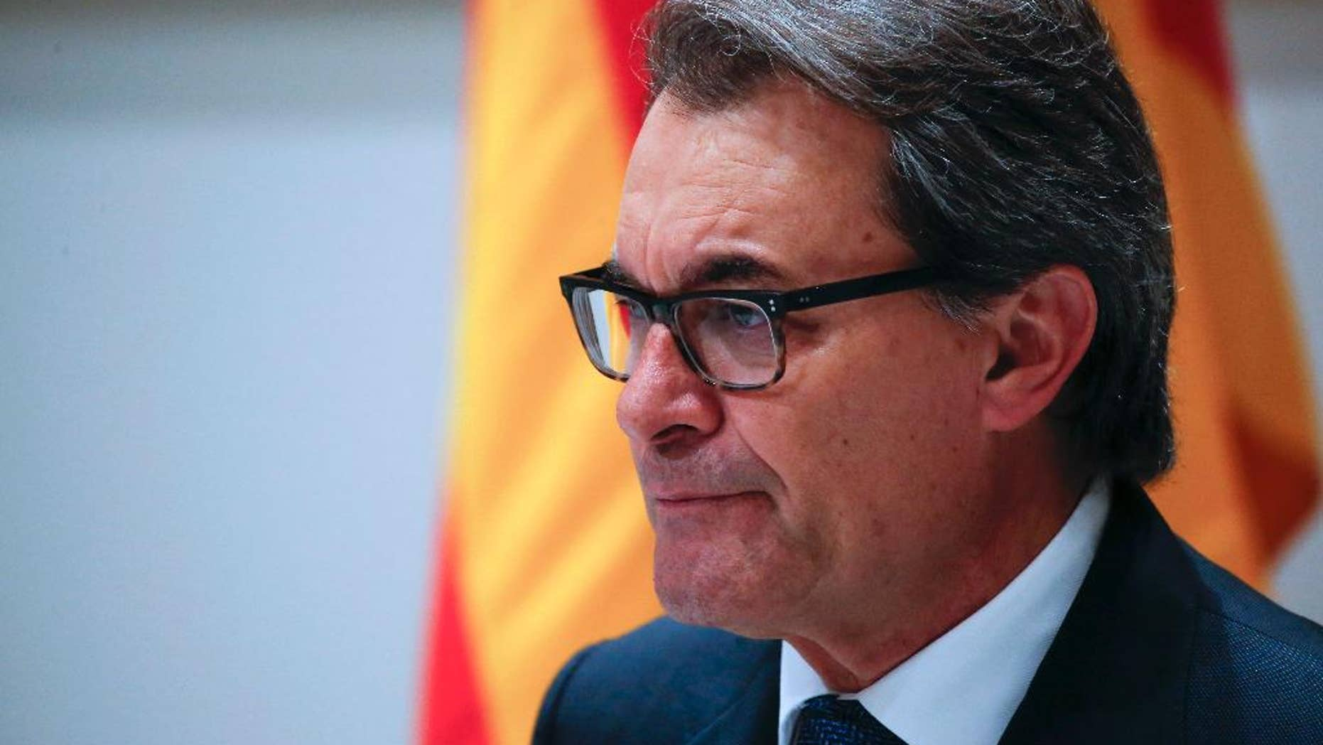 FILE - In this  Jan. 9, 2016 file photo, acting regional President Artur Mas pauses during a news conference in Barcelona. Spanish prosecutors said on Monday, Oct. 3, 2016 that they are seeking a 10-year disqualification from holding public office for former Catalan regional President Artur Mas for staging a vote on Catalonia's secession from Spain despite a suspension order by the Constitutional Court. (AP Photo/Emilio Morenatti, File)