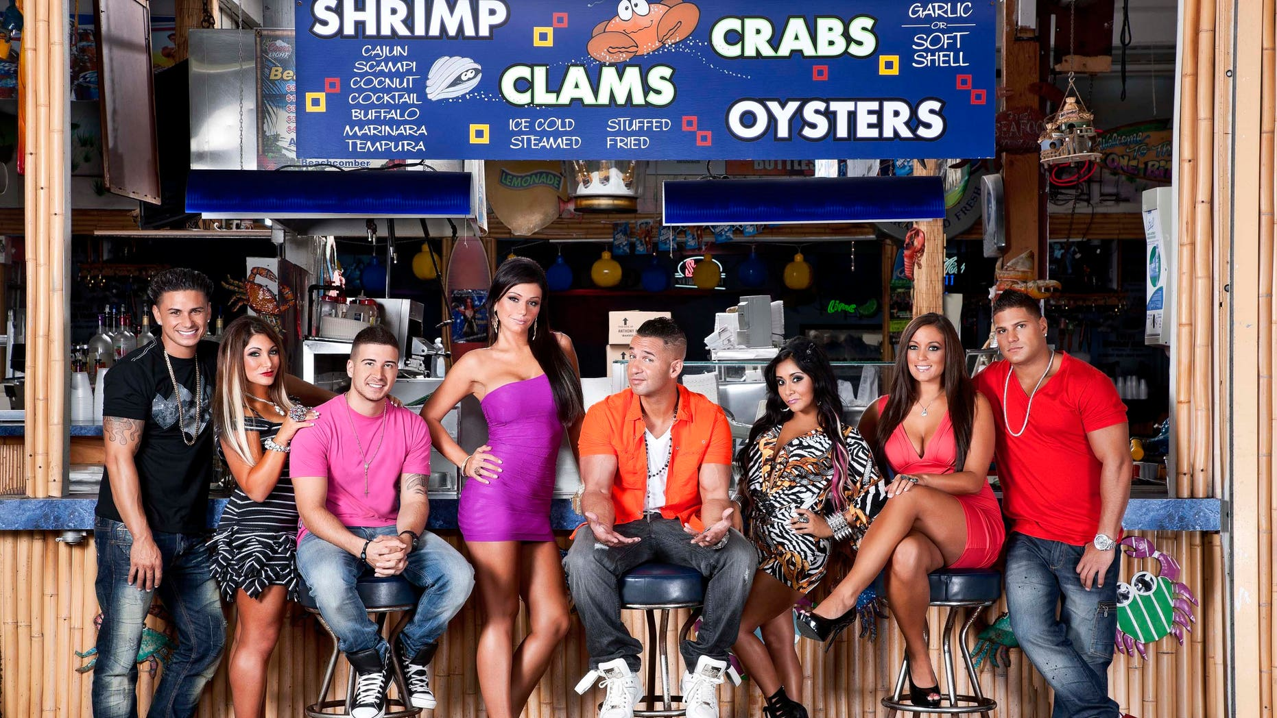 """This undated image released by MTV shows the cast of """"Jersey Shore,"""" from left, Paul """" DJ Pauly D"""" Delvecchio, Deena Nicole Cortese,  Vinny Guadagnino, Jenni """"JWOWW"""" Farley,  Mike """"The Situation"""" Sorrentino, Nicole """"Snooki"""" Polizzi,  Sammi """"Sweetheart"""" Giancola and Ronnie Magro in Seaside Heights, N.J. MTV gave the last call for """"Jersey Shore"""" on Thursday, Aug. 30, saying the raucous reality show will conclude after its upcoming sixth season, which begins Oct. 4. The series, whose roots lay in a party house in Seaside Heights, N.J., gave rise to such stars as Nicole """"Snooki"""" Polizzi and Mike """"The Situation"""" Sorrentino, while popularizing the terms """"guido"""" and """"guidette.""""  (AP Photo/MTV, Ian Spanier Photography)"""