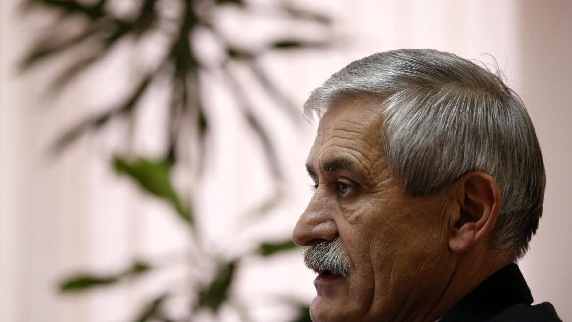 The head of a Serbian arms factory Milojko Brzakovic speaks during an interview with The Associated Press, in Belgrade, Serbia, Thursday, Dec. 10, 2015. Brzakovic of the Zastava arms factory told the Associated Press Thursday that the M92 semi-automatic pistol was traced after its serial number matched the one delivered to an American arms dealer in May 2013. (AP Photo/Darko Vojinovic)