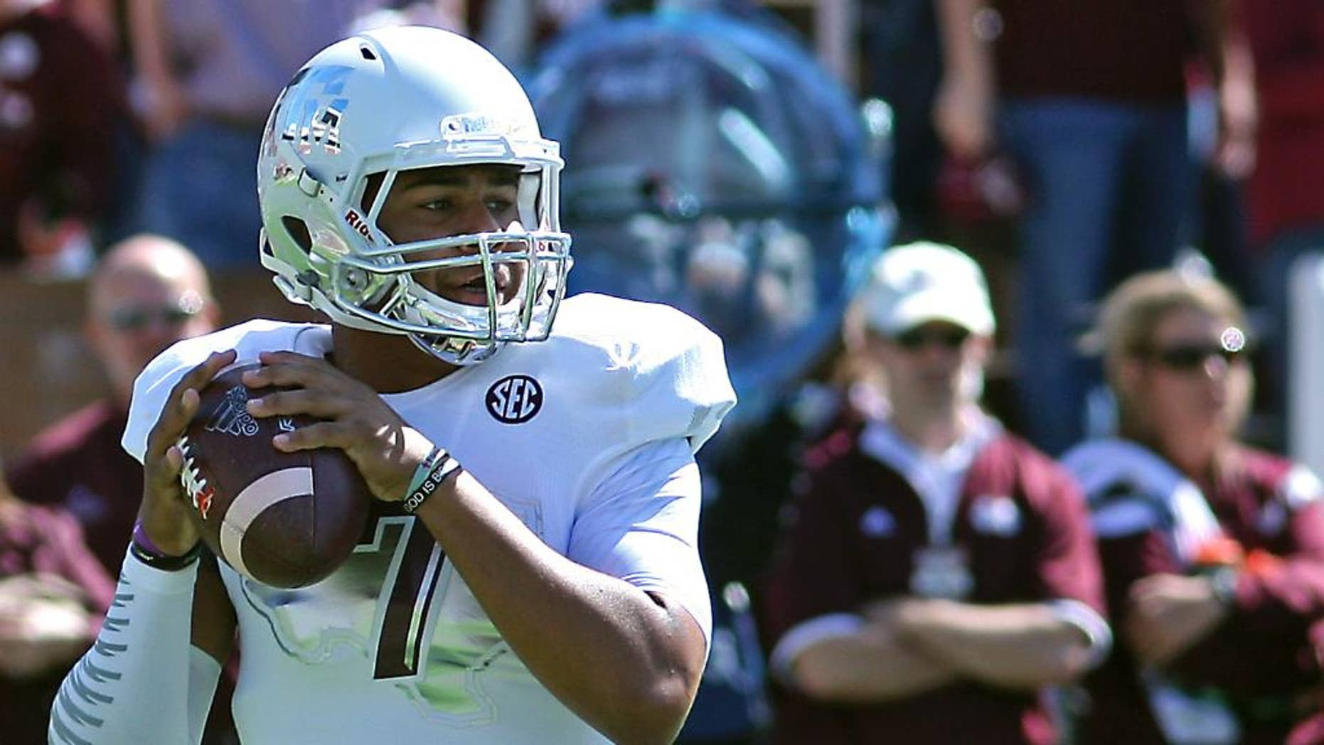 Texas A&M quarterback Kenny Hill (7) prepares throw a pass during the first half of an NCAA college football game against Mississippi State in Starkville, Miss., Saturday, Oct. 4, 2014. (AP Photo/Jim Lytle)