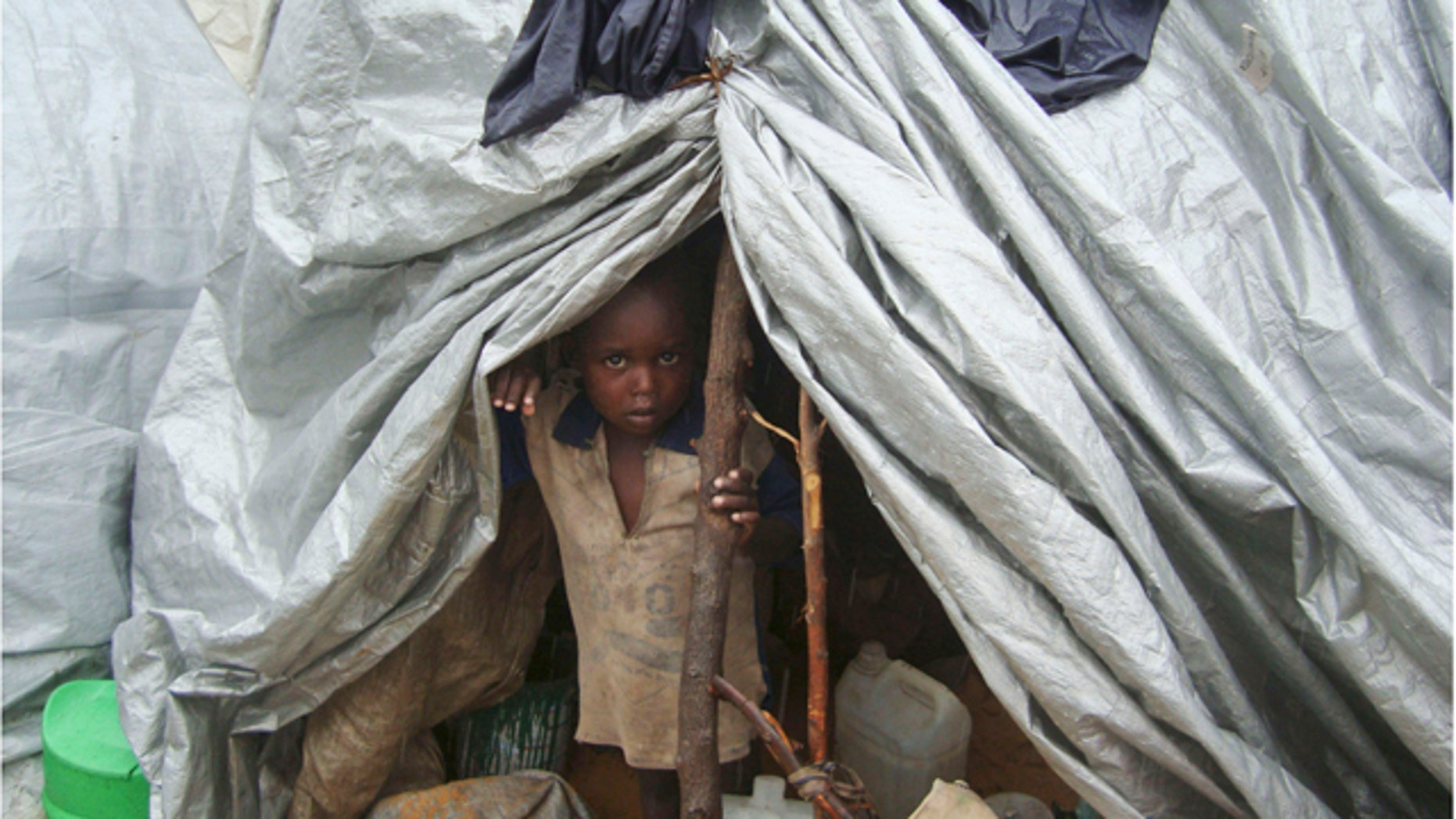 July 31: A young boy from southern Somalia takes cover in a makeshift shelter in Mogadishu.
