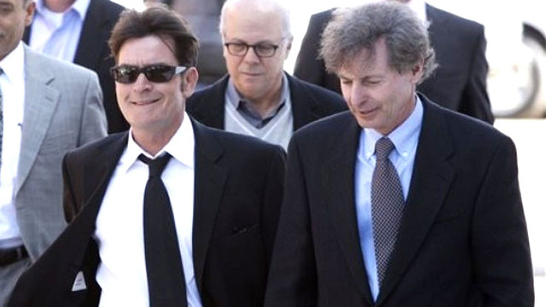 Charlie Sheen (left) and his lawyer leave a court hearing.