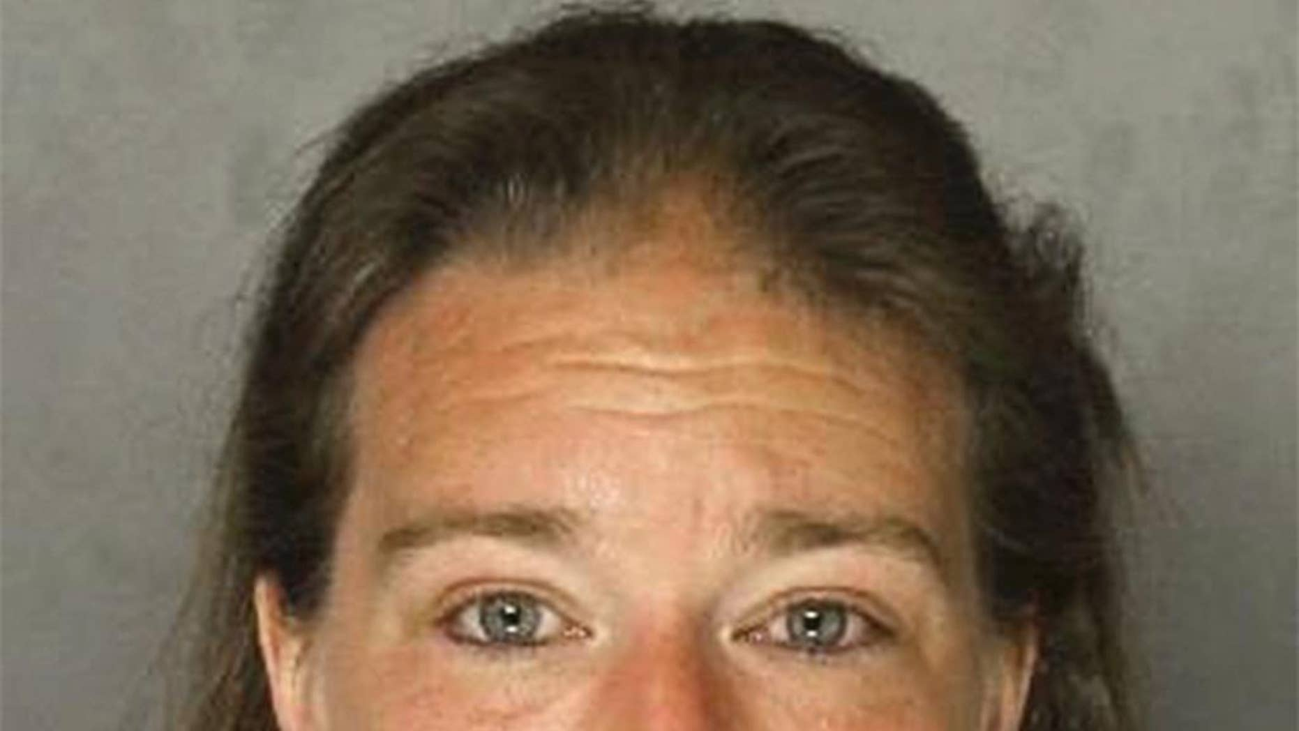 This photo provided by the Allegheny County Police Department in Pittsburgh shows Teresa Drum of Frazer Township, Pa., charged Tuesday, Feb. 28, 2017, with criminal homicide after police say she fatally shot her husband Dennis Drum Sr. on Monday, Feb. 27,  then took a cellphone photo of his body and showered before calling 911. Police say she told officers her husband complained she burned a casserole and drank his last beer, then shot himself as she called 911. But police say the photo was taken 11 minutes before the 911 call, and there was no gun in the body's hand in the photo. (Allegheny County Police Department via AP)