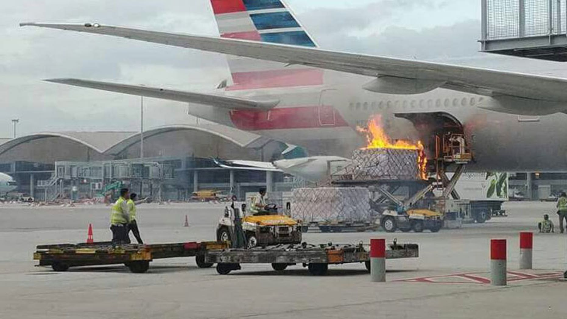 A piece of loading equipment and its cargo caught fire at Hong Kong International Airport on Monday.