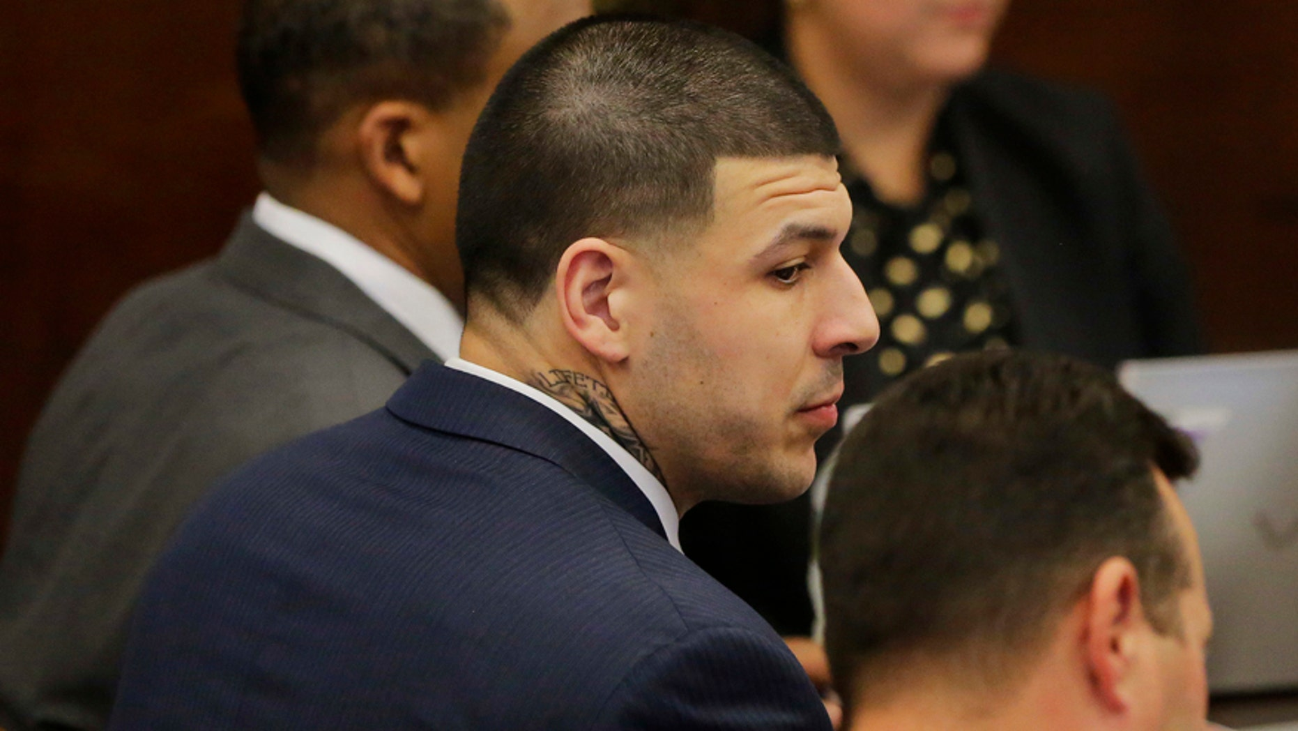 Former New England Patriots tight end Aaron Hernandez sits with his attorneys Jose Baez, right, and Ronald Sullivan, left, at the opening of the fist day of his double murder trial at Suffolk Superior Court on Wednesday, March 1, 2017, in Boston. Hernandez is standing trial for the July 2012 killings of Daniel de Abreu and Safiro Furtado who he encountered in a Boston nightclub. He is already serving a life sentence in the 2013 killing of semi-professional football player Odin Lloyd. (AP Photo/Stephan Savoia, Pool)