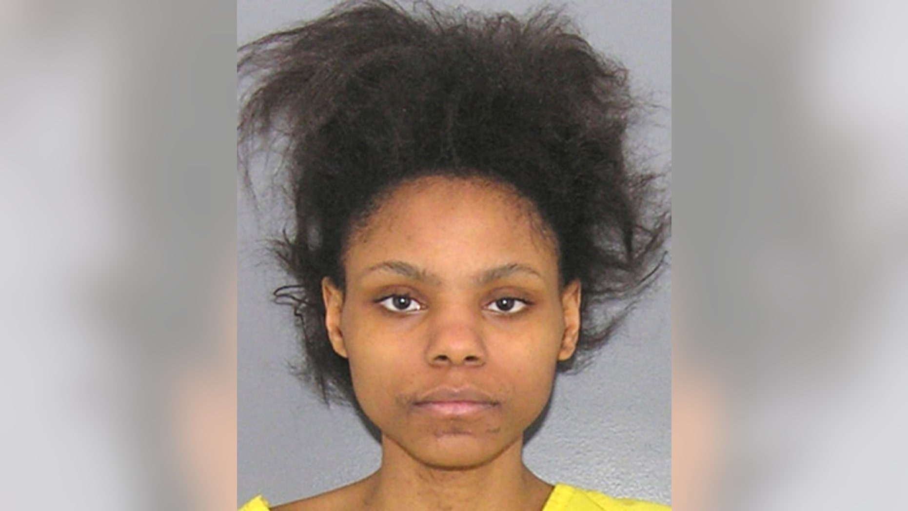 FILE - This booking photo provided by the Hamilton County, Ohio Sheriff shows Deasia Watkins in Cincinnati.  A Hamilton County judge on Tuesday, April 28, 2015, found Watkins incompetent for trial on an aggravated murder charge.  Watkins, 20, is accused of decapitating her 3-month-old daughter.  (Hamilton County Sheriff via AP)