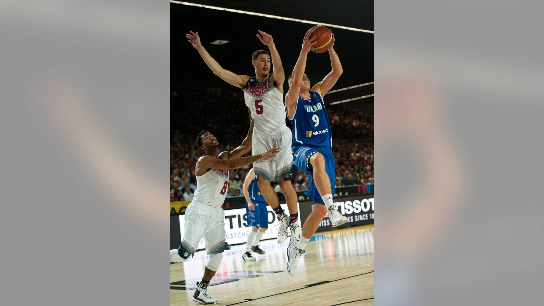 Finland's Sasu Salin,  tries to controls the ball between United States's Klay Thompson, and Derrick Rose, left, during the Group C Basketball World Cup match between United States and Finland,  in Bilbao northern Spain, Saturday, Aug. 30, 2014. The 2014 Basketball World Cup competition will take place in various cities in Spain from Aug. 30 through to Sept. 14. (AP Photo/Alvaro Barrientos)
