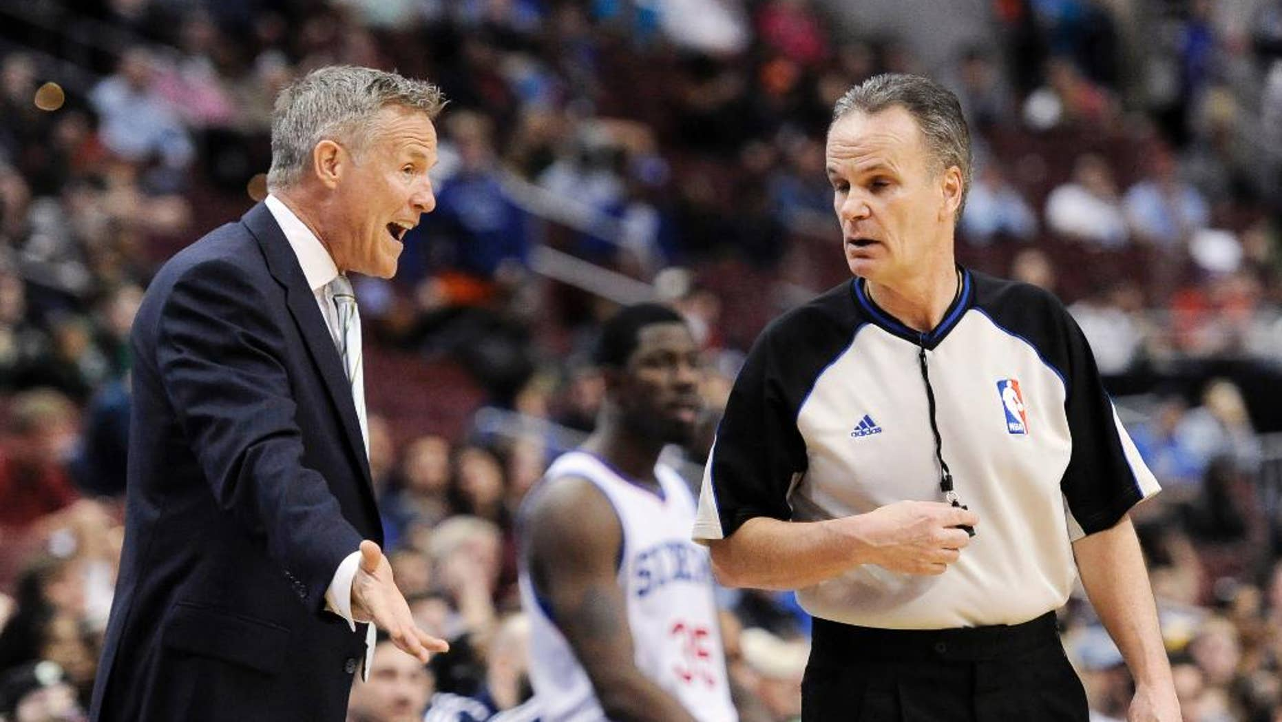 Philadelphia 76ers head coach Brett Brown argues a with official Mike Callahan during the second half of an NBA basketball game on Monday, April 14, 2014, in Philadelphia. The 76ers won 113-108. (AP Photo/Michael Perez)