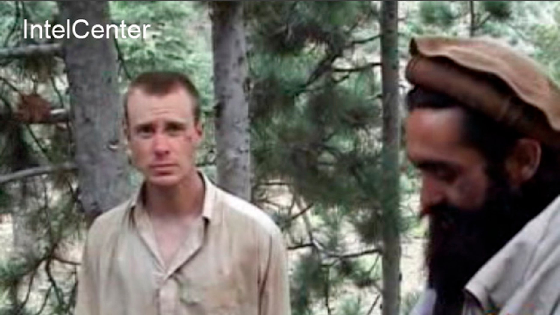 Dec. 8, 2010: This file image provided by IntelCenter shows a framegrab from a video released by the Taliban containing footage of a man believed to be Sgt. Bowe Bergdahl, left. (AP/Intel Center)