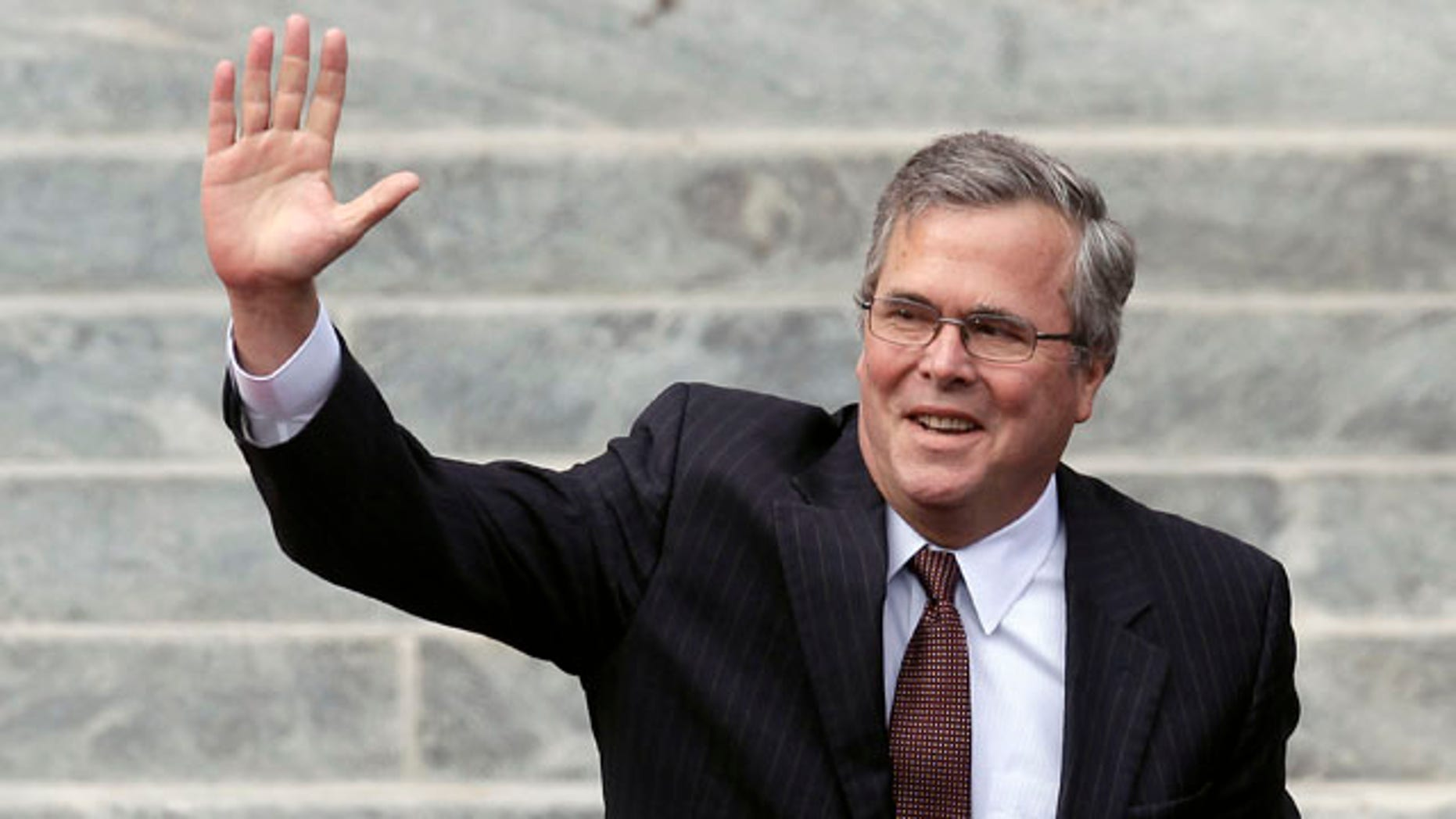 Former Florida Gov. Jeb Bush waves as he is introduced to the crowd during inauguration ceremonies for Republican Rick Scott outside the Old Capitol in Tallahassee, Fla.