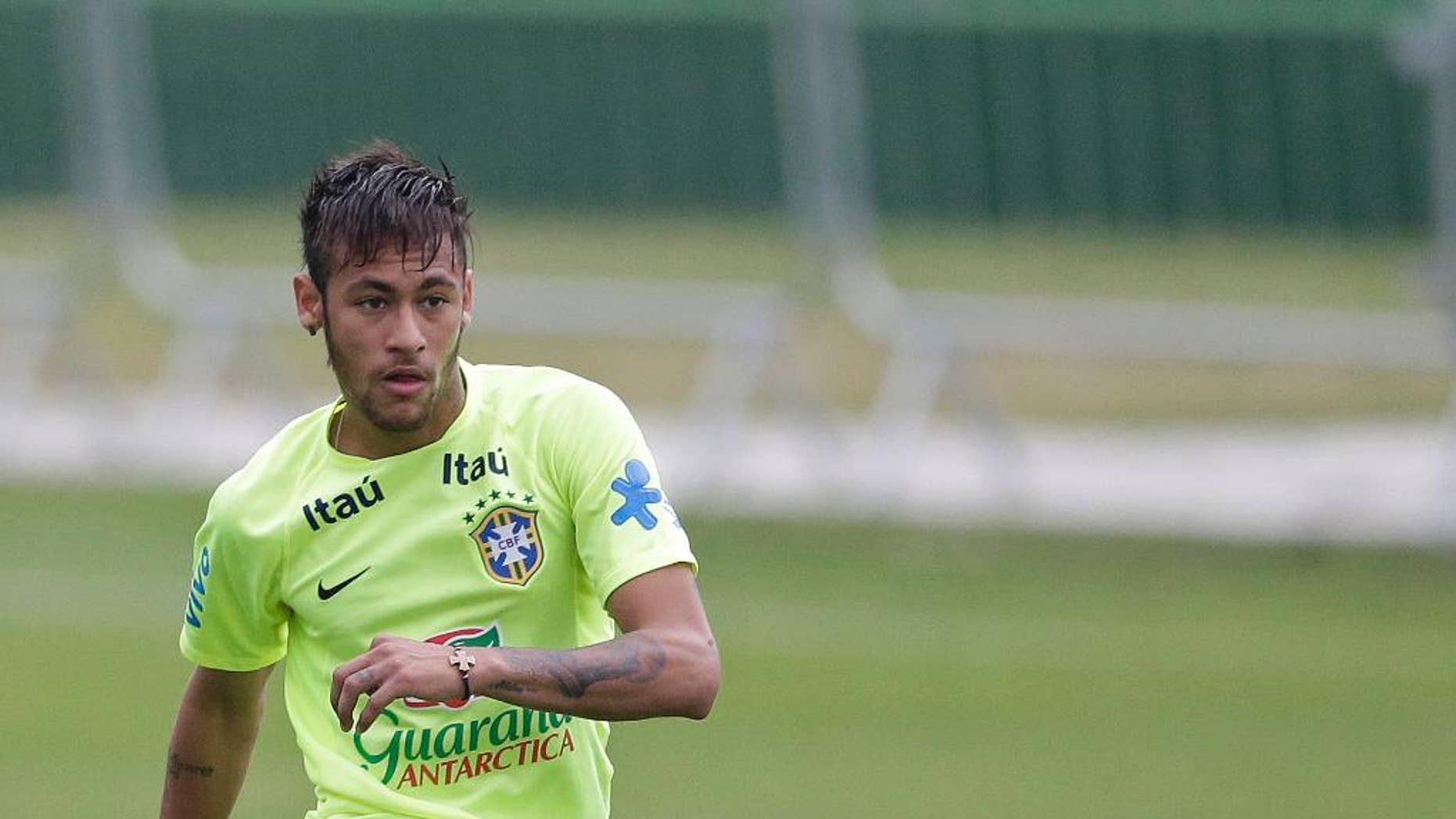 Brazil's Neymar practices during a training session of the Brazilian national soccer team, at the Granja Comary training center in Teresopolis, Brazil, Monday, June 9, 2014. Brazil plays in group A of the 2014 soccer World Cup. (AP Photo/Andre Penner)