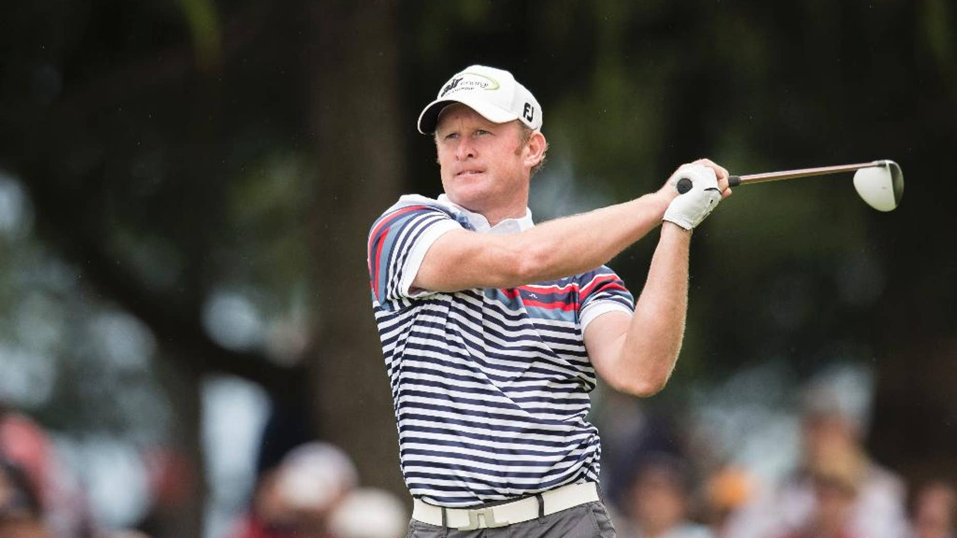 Jamie Donaldson of Wales tees off at hole 9 during the second round of the Omega European Masters Golf Tournament in Crans-Montana, Switzerland, Friday, September 5, 2014.  (AP Photo/Keystone/Ennio Leanza)