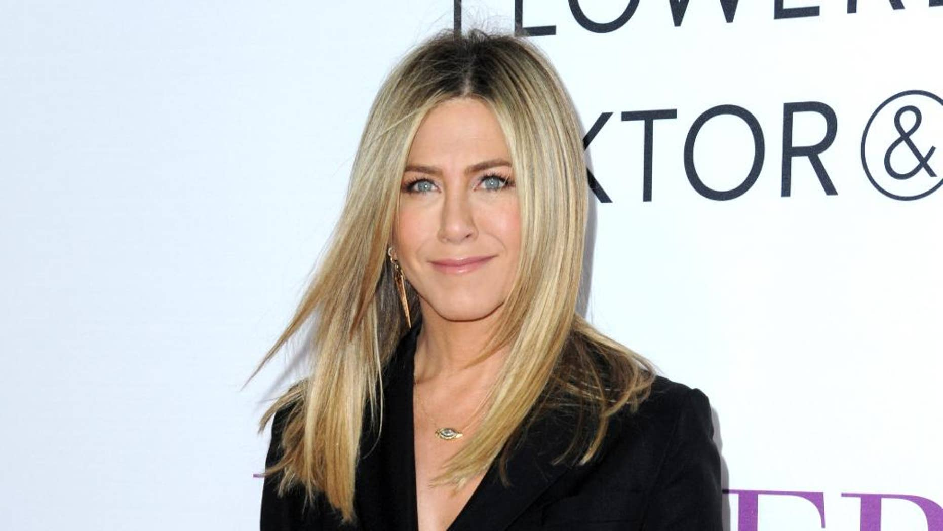 """FILE - In this April 13, 2016 file photo, Jennifer Aniston arrives at the Los Angeles premiere of """"Mother's Day."""" Aniston says she's not pregnant and she's fed up with predatory tabloid culture that defines women by their looks and maternal status.  (Photo by Richard Shotwell/Invision/AP, File)"""