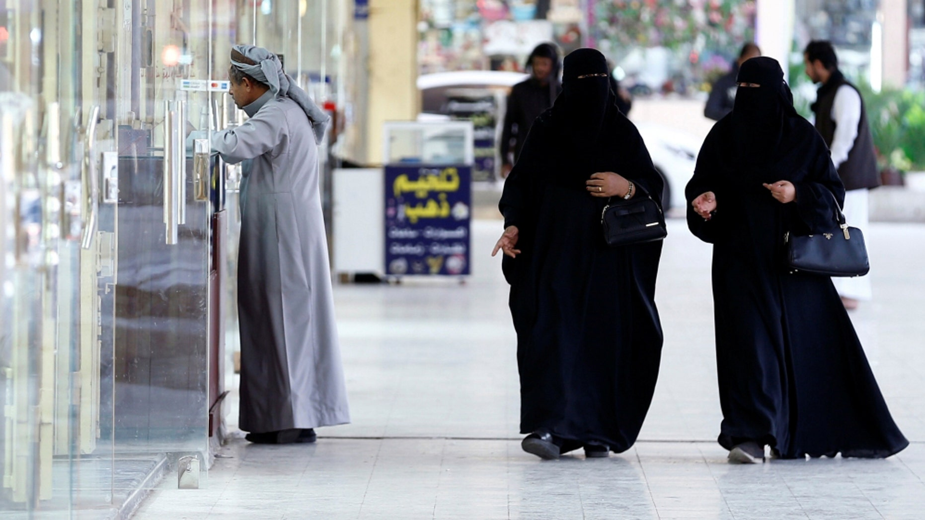 A top cleric in Saudi Arabia said Friday that women should not be forced to wear long black robes any longer.