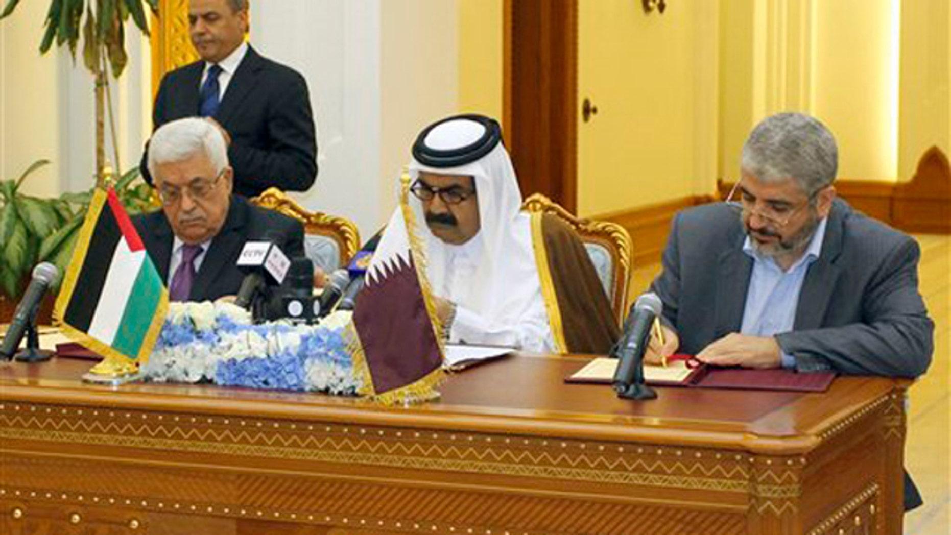 Feb. 6, 2012: Palestinian President Mahmoud Abbas, left, Emir of Qatar Sheikh Hamad bin Khalifa Al Thani, center, and Hamas leader Khaled Mashaal, right, sign an agreement in Doha, Qatar.