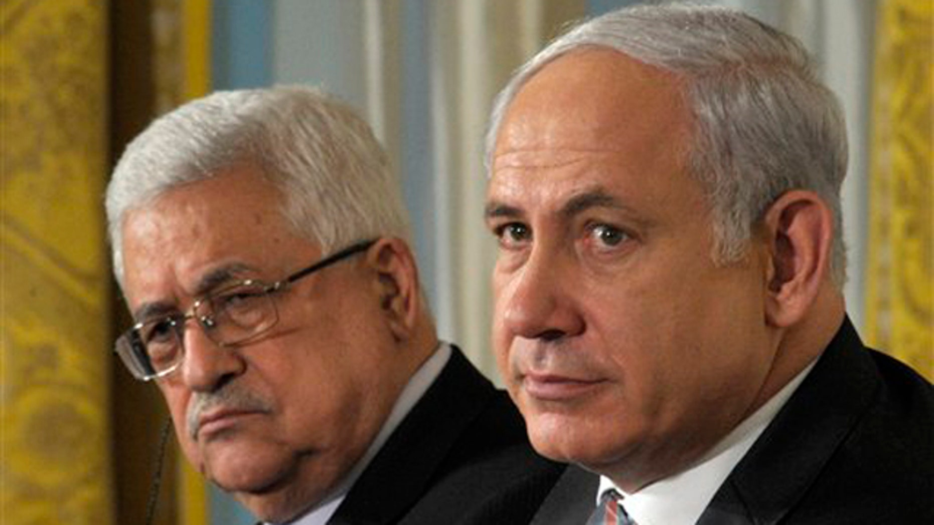 Sept. 1, 2010: Palestinian President Mahmoud Abbas, left, and Israel's Prime Minister Benjamin Netanyahu listen during remarks at the White House.