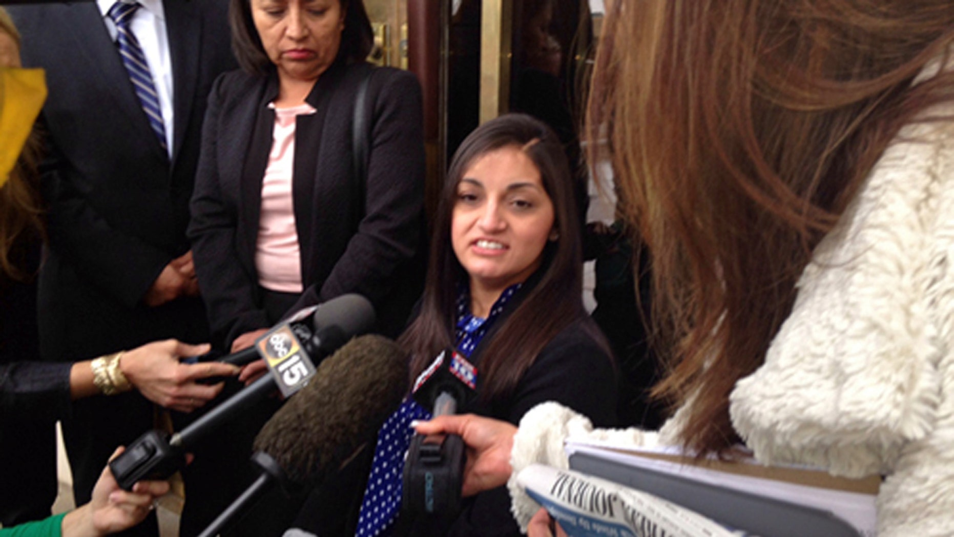 """April """"Abby"""" Guerra speaks to reporters in Phoenix Friday, May 8, 2015."""