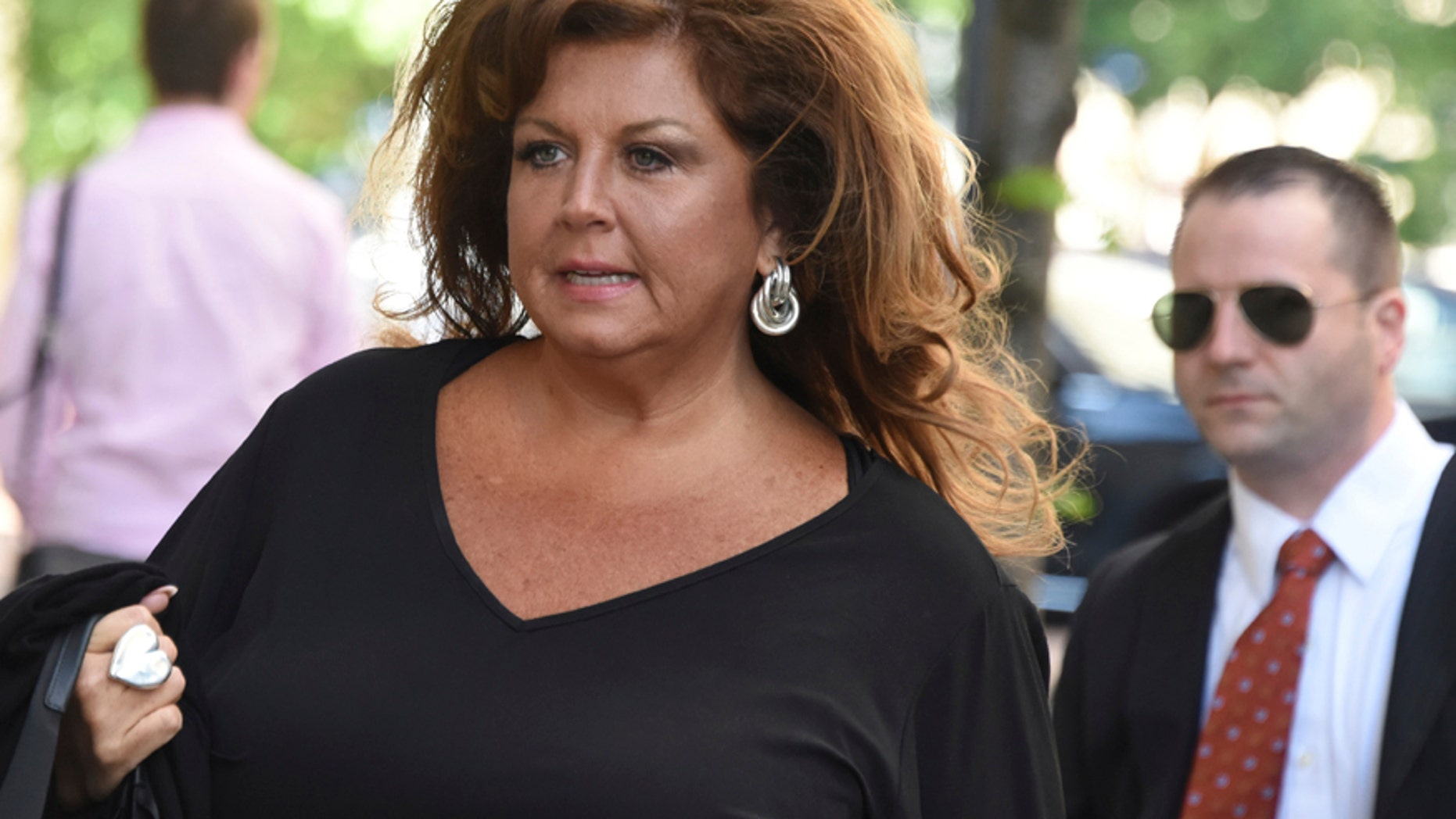 "Former ""Dance Moms"" reality star Abby Lee Miller arrives at the Joseph F. Weis Jr. U. S. Courthouse in Pittsburgh for her sentencing on federal bankruptcy fraud charges, Monday, May 8, 2017."