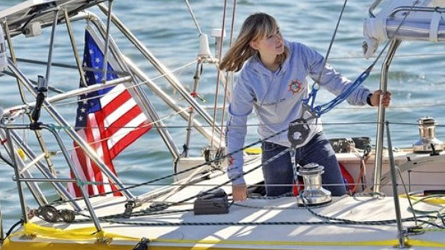 Abby Sunderland, 16, looks out from her sailboat, Wild Eyes, as she leaves for her world record attempting journey at the Del Rey Yacht Club in Marina del Rey, Calif.  (AP)