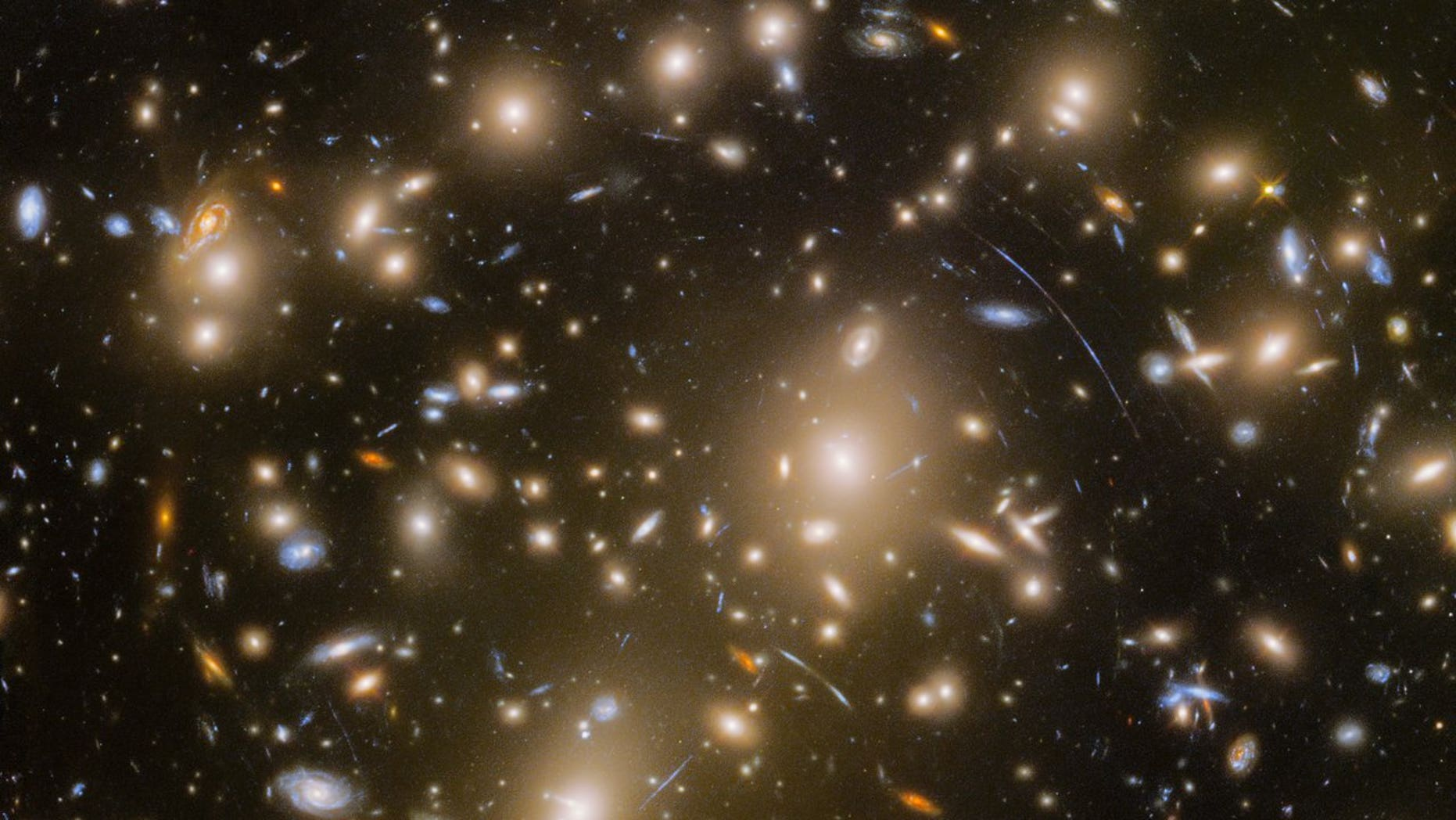 This new Hubble view features a distant galaxy cluster called Abell 370. It also captures numerous cosmic objects that are magnified by the powerful gravitational force of the galaxy cluster.