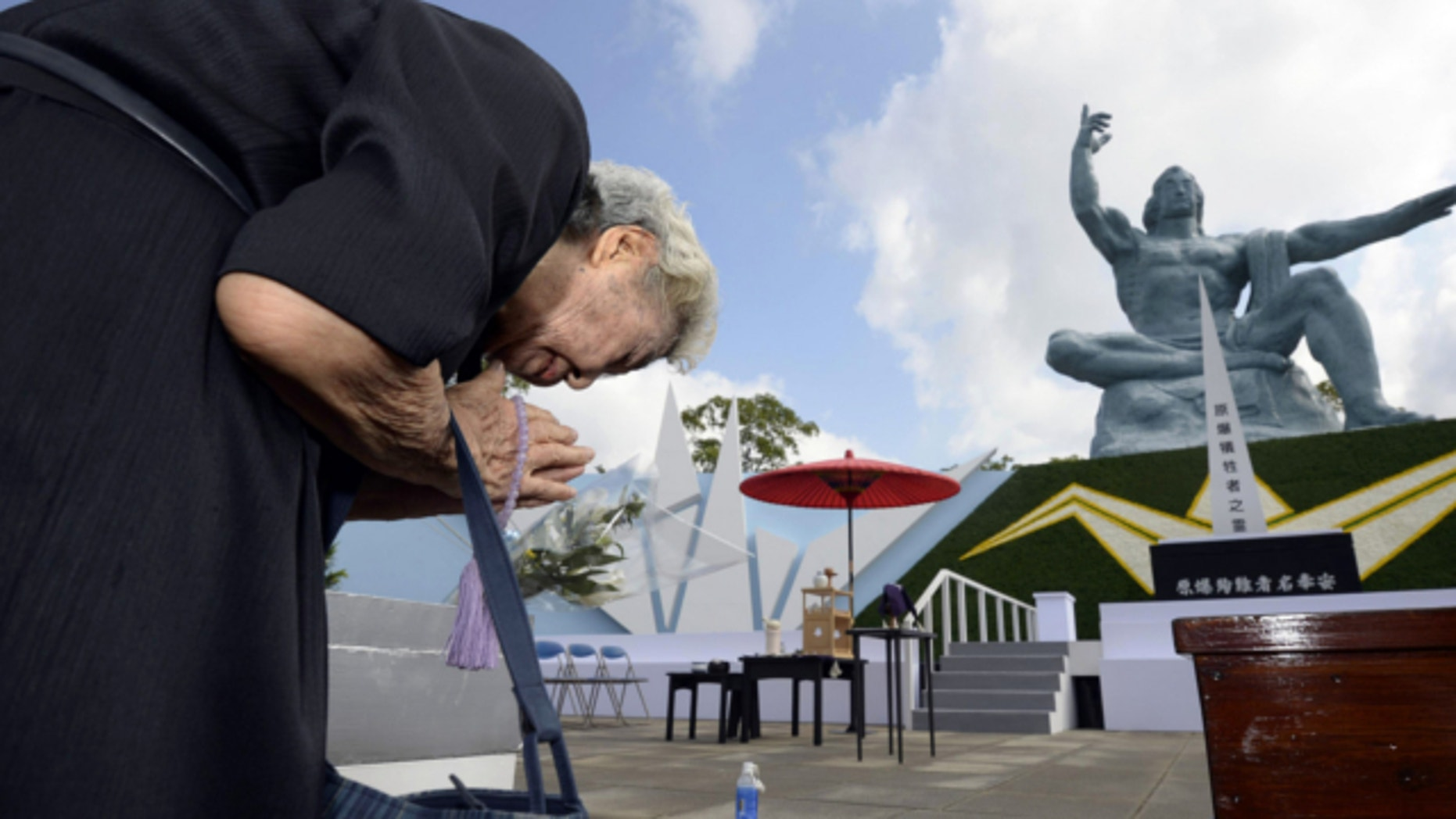 Aug. 9, 2013: A woman offers prayers at Nagasaki Peace Park in Nagasaki, southern Japan to mark the 68th anniversary of the world's second atomic bomb attack over the city.