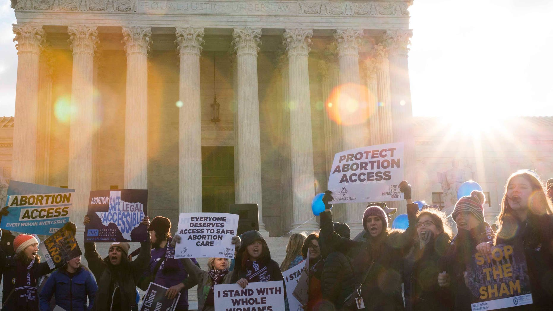 WASHINGTON, DC - MARCH 02:  Pro-choice advocates rally outside of the Supreme Court on March 2, 2016 in Washington, DC.  On Wednesday morning, the Supreme Court will hear oral arguments in the Whole Woman's Health v. Hellerstedt case, where the justices will consider a Texas law requiring that clinic doctors have admitting privileges at local hospitals and that clinics upgrade their facilities to standards similar to hospitals. (Drew Angerer/Getty Images)