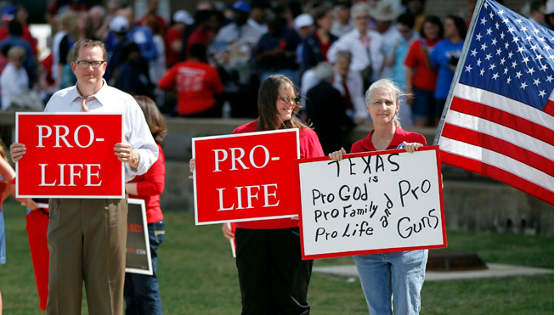Oct.3 , 2013: Protesters gather outside W.G. Thomas Coliseum in Haltom City, Texas.