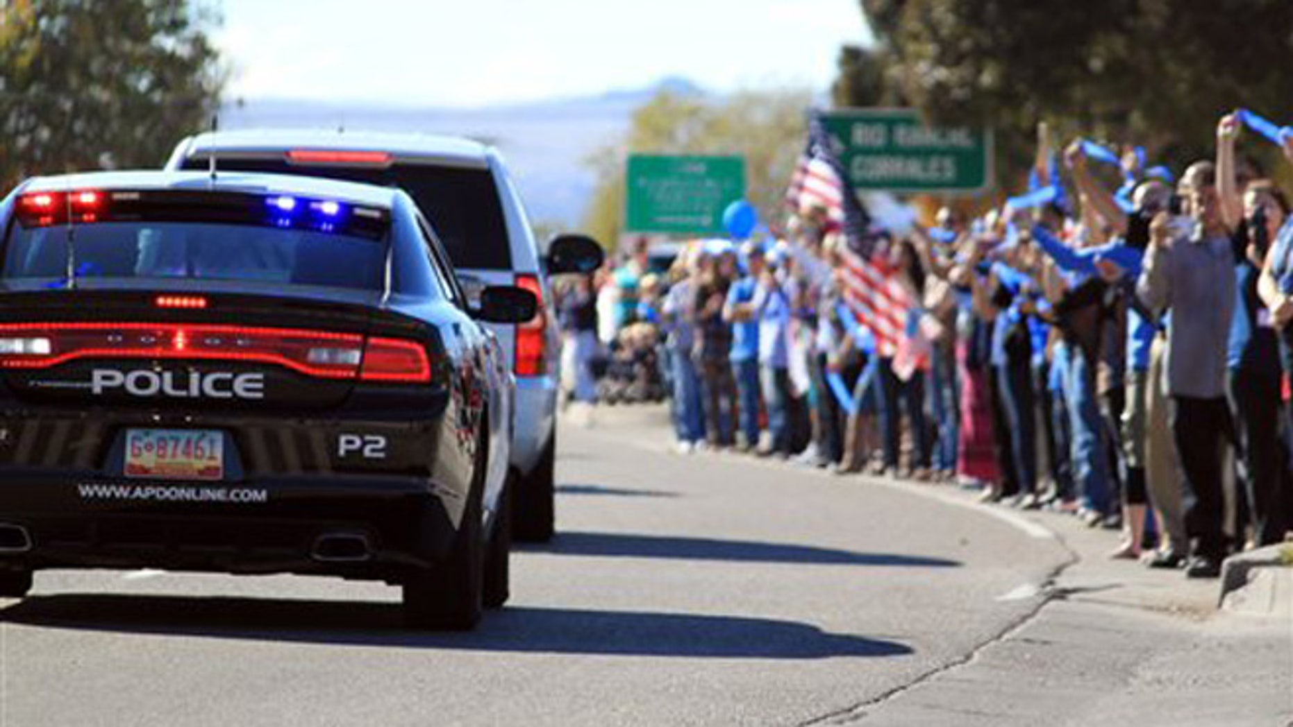 Nov. 3, 2015: Thousands of people line the route for slain Albuquerque Police Officer Daniel Webster's funeral procession in Albuquerque, N.M.