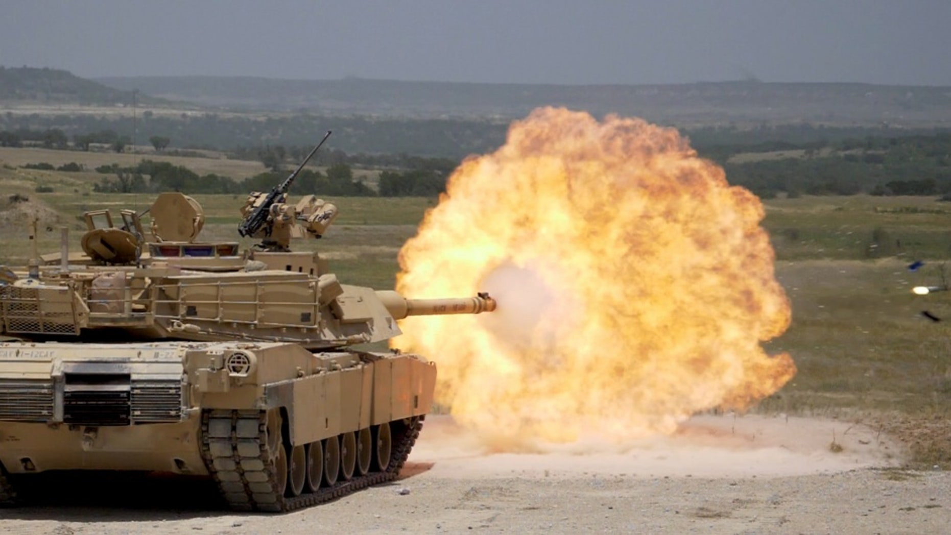 File photo - FORT HOOD, Tx--A Sabot round is fired from an M1A2 Abrams tank during 3rd Armored Brigade, 1st Cavalry Division gunnery qualification.