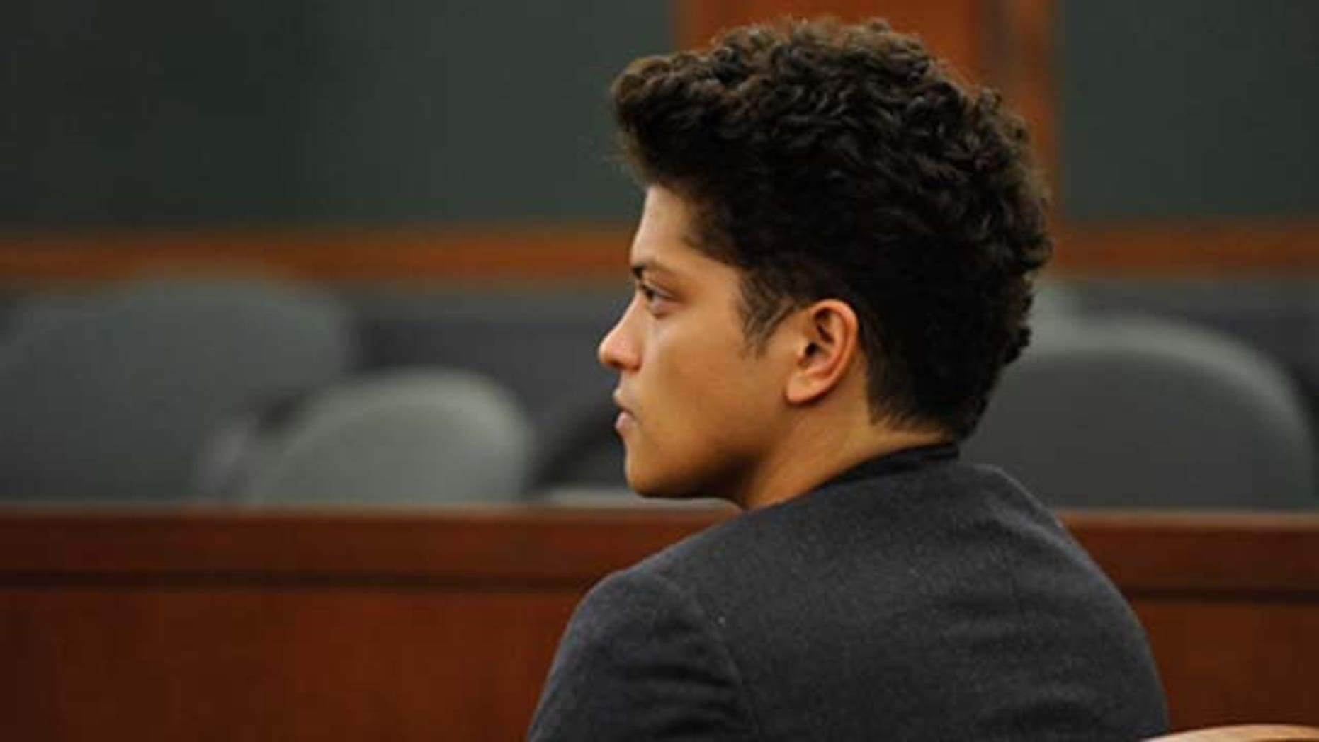 Recording artist Bruno Mars appears at the Clark County Regional Justice Center on a felony drug possession charge February 16, 2011 in Las Vegas, Nevada. Mars, whose legal name is Peter Hernandez, was arrested last September at the Hard Rock Hotel & Casino for possession of cocaine. Mars pleaded guilty to the charge and was placed on a year of informal probation as part of a deal. He will have to pay a USD 2,000 fine, perform 200 hours of community service, and attend drug counseling. If he completes the terms of the agreement, the charge will be dismissed.