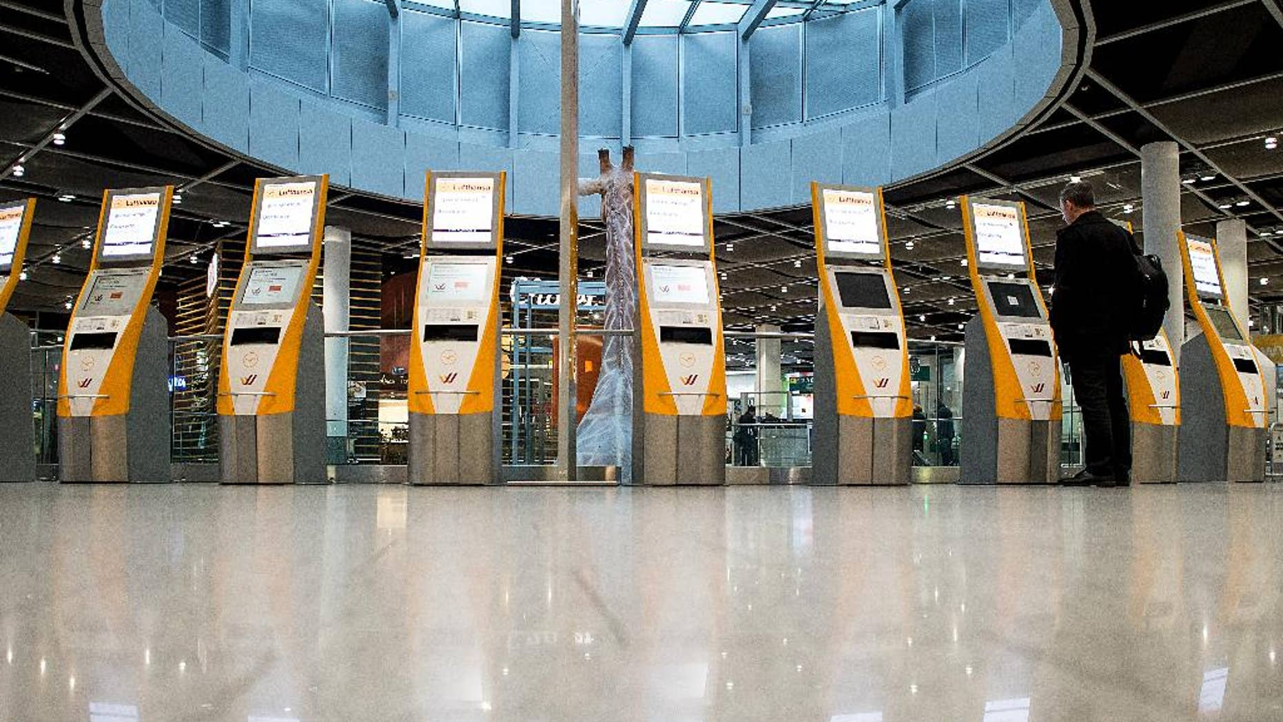 Unused check-in terminals are reflected on the floor in the airport in Duesseldorf, western Germany, Friday morning, March 20, 2015. Lufthansa pilots continue their  strike in a dispute centering on the airline's plans to cut transition payments for pilots wanting to retire early, which the union wants to see maintained continues. (AP Photo/dpa,  Maja Hitij)