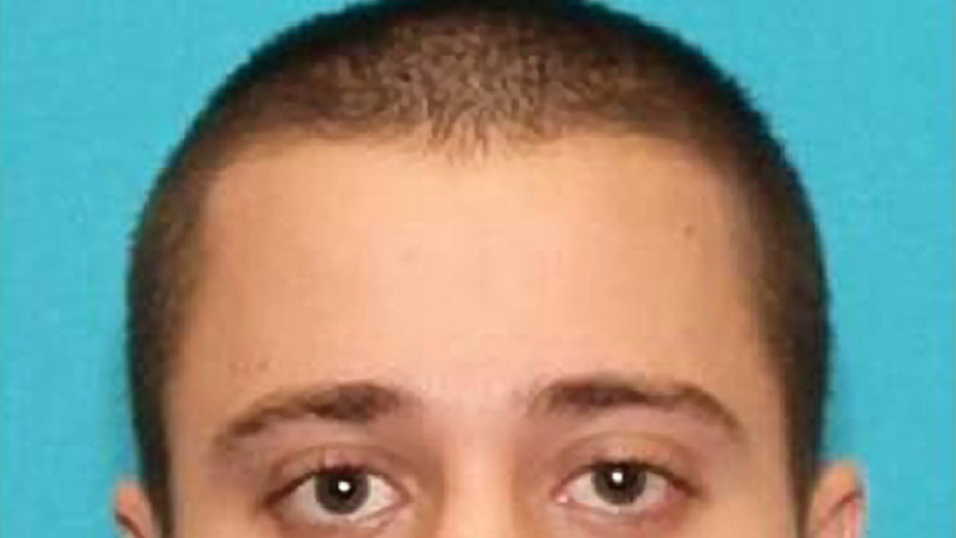 """This photo provided by the FBI shows Paul Ciancia, 23. Ciancia carrying a note that said he wanted to """"kill TSA"""" pulled a semi-automatic rifle from a bag and shot his way past a security checkpoint at Los Angeles International Airport on Friday, Nov. 1, 2013 killing one Transportation Security Administration officer and wounding two others, authorities said. (AP Photo/FBI)"""