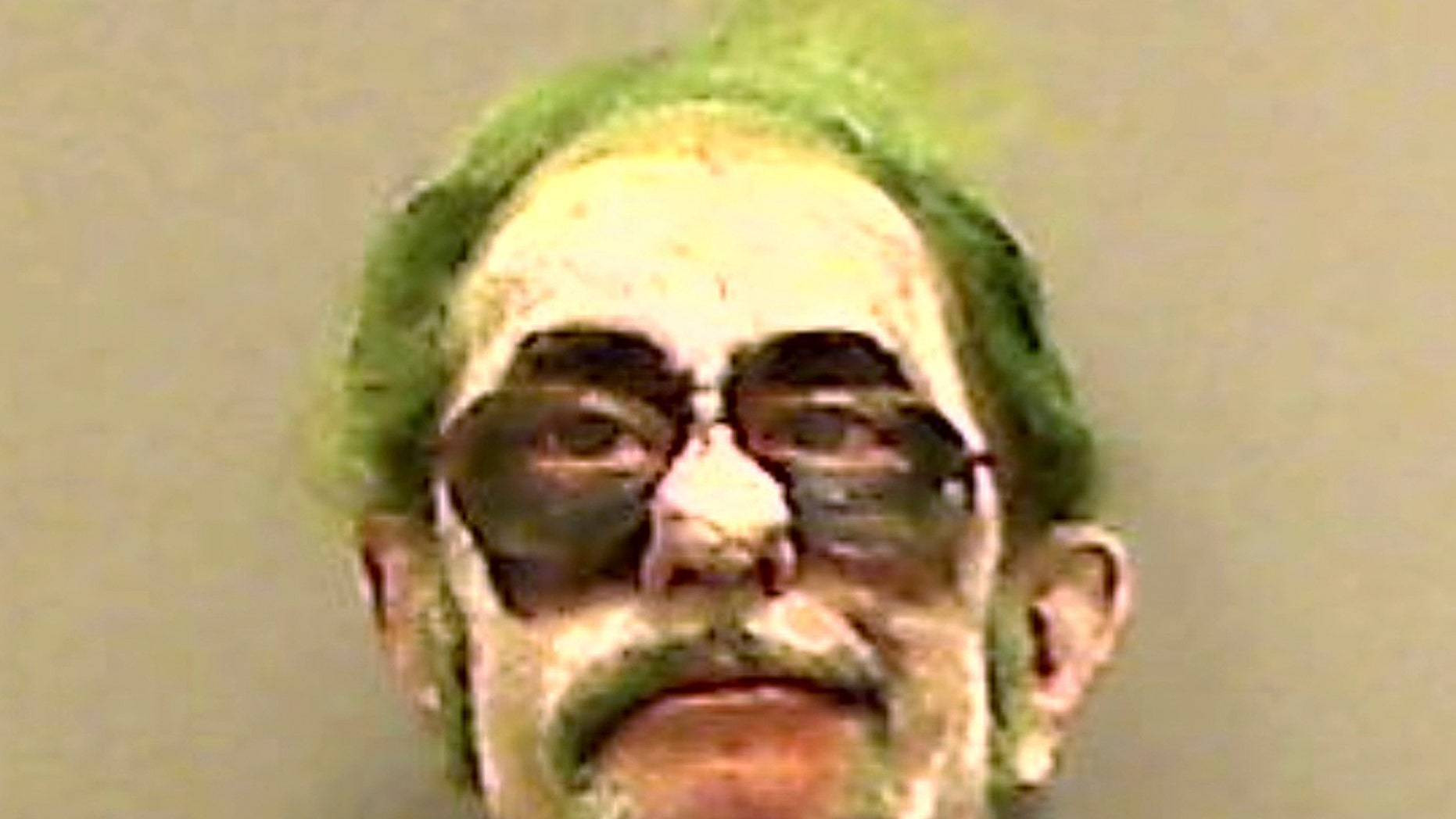 """This booking photo provided by the Somerset County Sheriff's Department shows Dennis Lalime, arrested Sunday, Oct. 20, 2013, when returning from a Halloween party made up as """"The Joker,"""" and charged with drunken driving after crashing his car in Pittsfield, Maine. (AP Photo/ Somerset County Sheriff's Department)"""