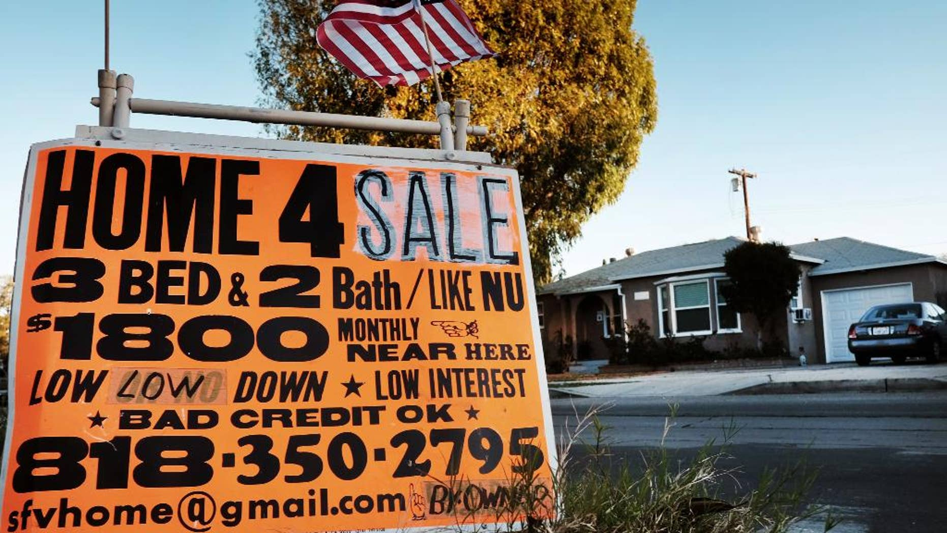 This Saturday, Jan. 17, 2015 photo shows a sign advertising a house for sale in Los Angeles.  Standard & Poor's releases its 20-city home price index for December and the fourth quarter on Tuesday, Feb. 24, 2015. (AP Photo/Richard Vogel)