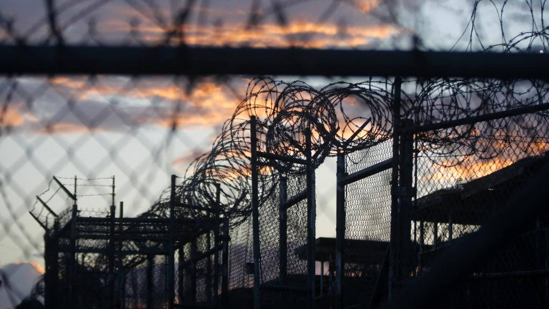 Nov. 21, 2013: Dawn arrives at the now closed Camp X-Ray, which was used as the first detention facility for Al Qaeda and Taliban militants who were captured after the Sept. 11 attacks, at the Guantanamo Bay Naval Base, Cuba. (AP Photo/Charles Dharapak, File)