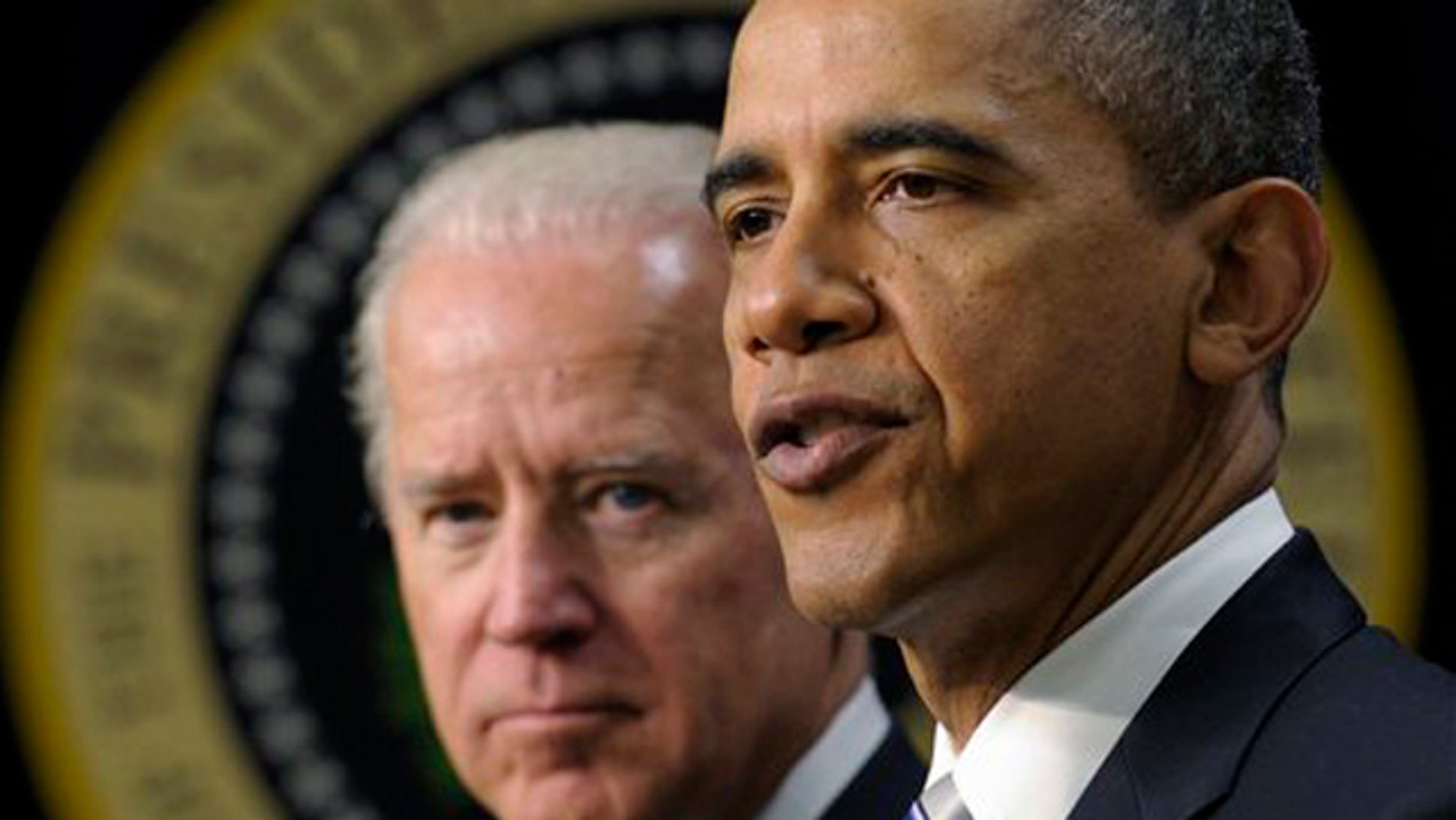 FILE - In a Feb. 21, 2012 file photo President Barack Obama, accompanied by Vice President Joe Biden, speaks in the Eisenhower Executive Office Building on the White House complex in Washington.  A previously undisclosed Biden memo to Obama in November 2009 reflects his view that military commanders were asking Obama to take a leap by adding tens of thousands of forces in Afghanistan whose role was poorly defined.   (AP Photo/Susan Walsh/file)