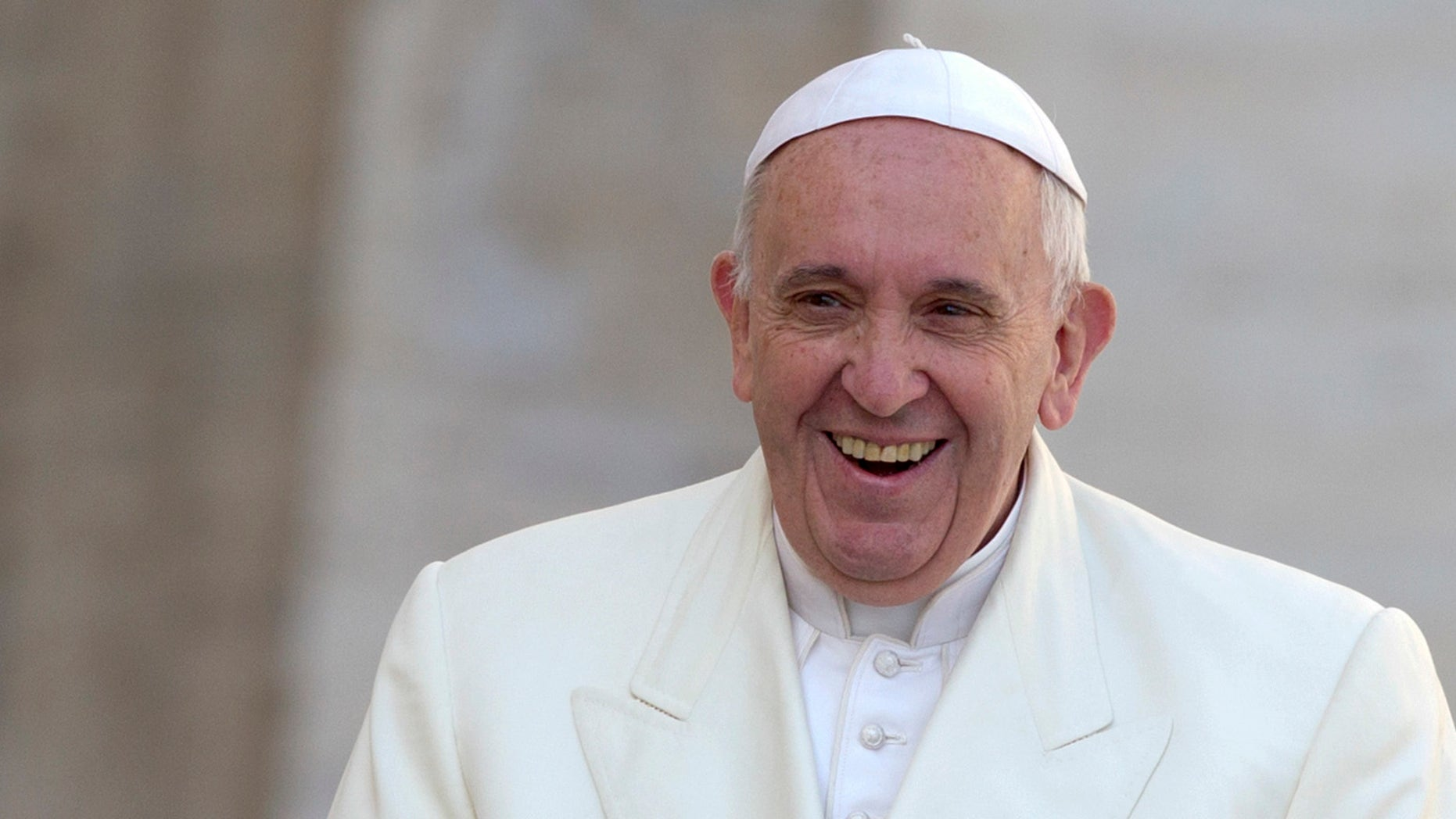 Pope Francis smiles to faithful as he arrives  in St. Peter's Square to attend an audience as part of the Jubilee of Mercy celebrations at the Vatican, Saturday, March 12, 2016. (AP Photo/Riccardo De Luca)