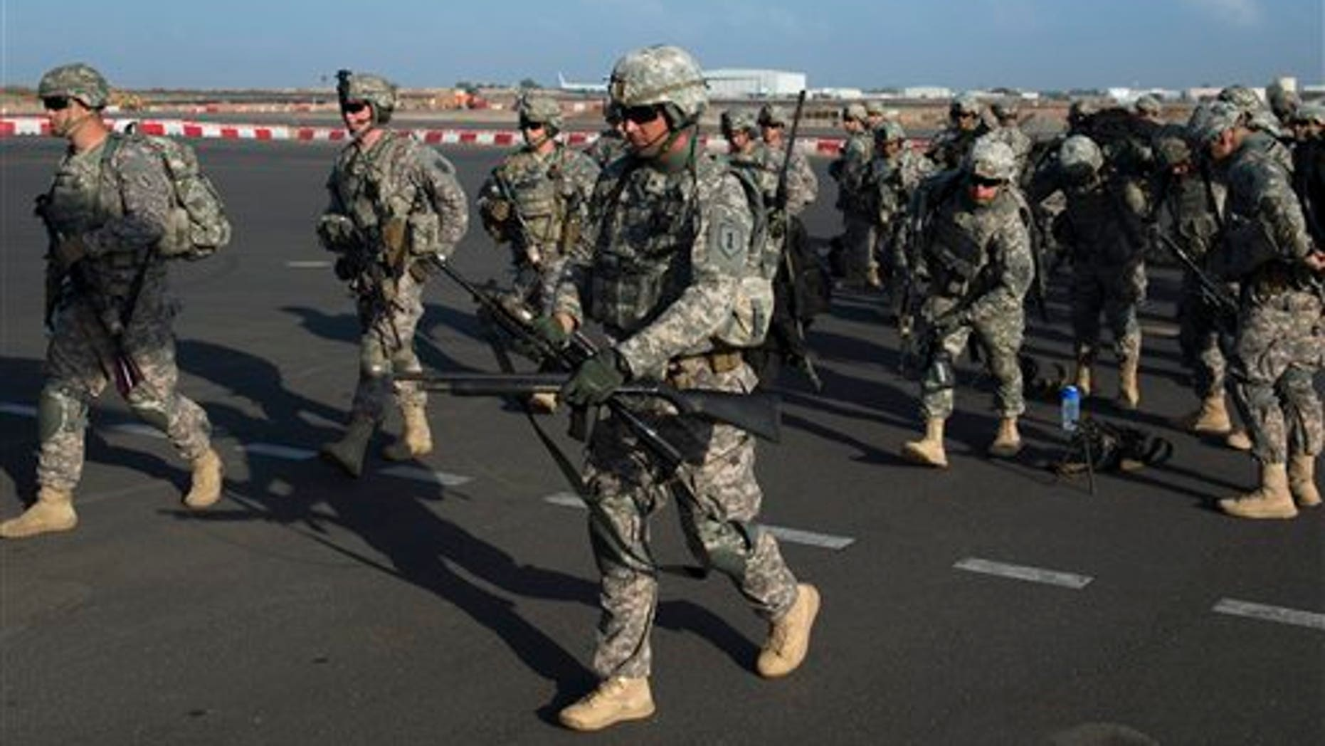 In this photo taken Wednesday, Dec. 18, 2013 and released by the U.S. Air Force, U.S. Army soldiers of the East Africa Response Force (EARF), a Djibouti-based joint team assigned to Combined Joint Task Force-Horn of Africa, prepare to load onto a U.S. Air Force C-130 Hercules at Camp Lemonnier, Djibouti, to support with an ordered departure of personnel from Juba, South Sudan. Gunfire hit three U.S. military CV-22 Osprey aircraft Saturday, Dec. 21, 2013 trying to evacuate American citizens in Bor, the capital of the remote region of Jonglei state in South Sudan, that on Saturday became a battle ground between South Sudan's military and renegade troops, officials said, with four U.S. service members wounded in the attack. (AP Photo/U.S. Air Force, Tech. Sgt. Micah Theurich)